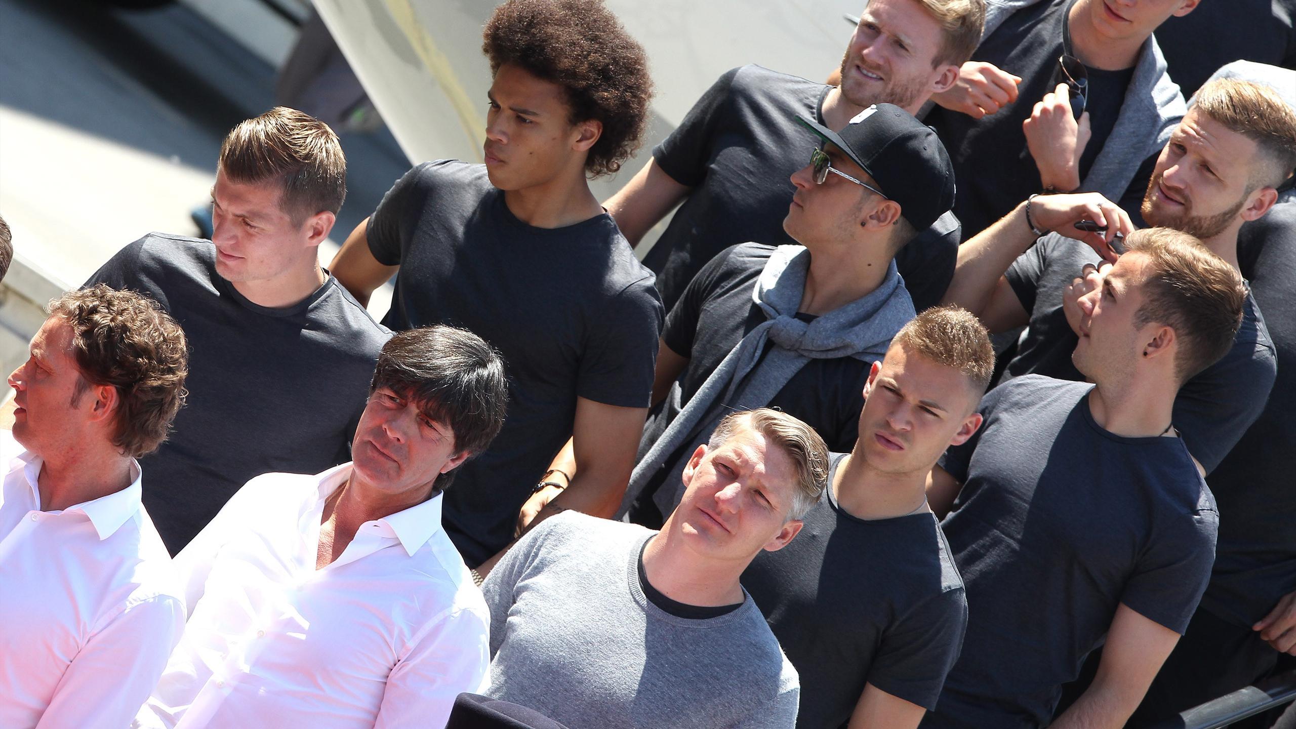Germany's head coach Joachim Loew (front row, L to R),Germany's midfielder Bastian Schweinsteiger, midfielder Joshua Kimmich, forward Mario Goetze, defender Shkodran Mustafi, (Back row, L to R) midfielder Toni Kroos,forward Leroy Sane, midfielder Mesut Oe