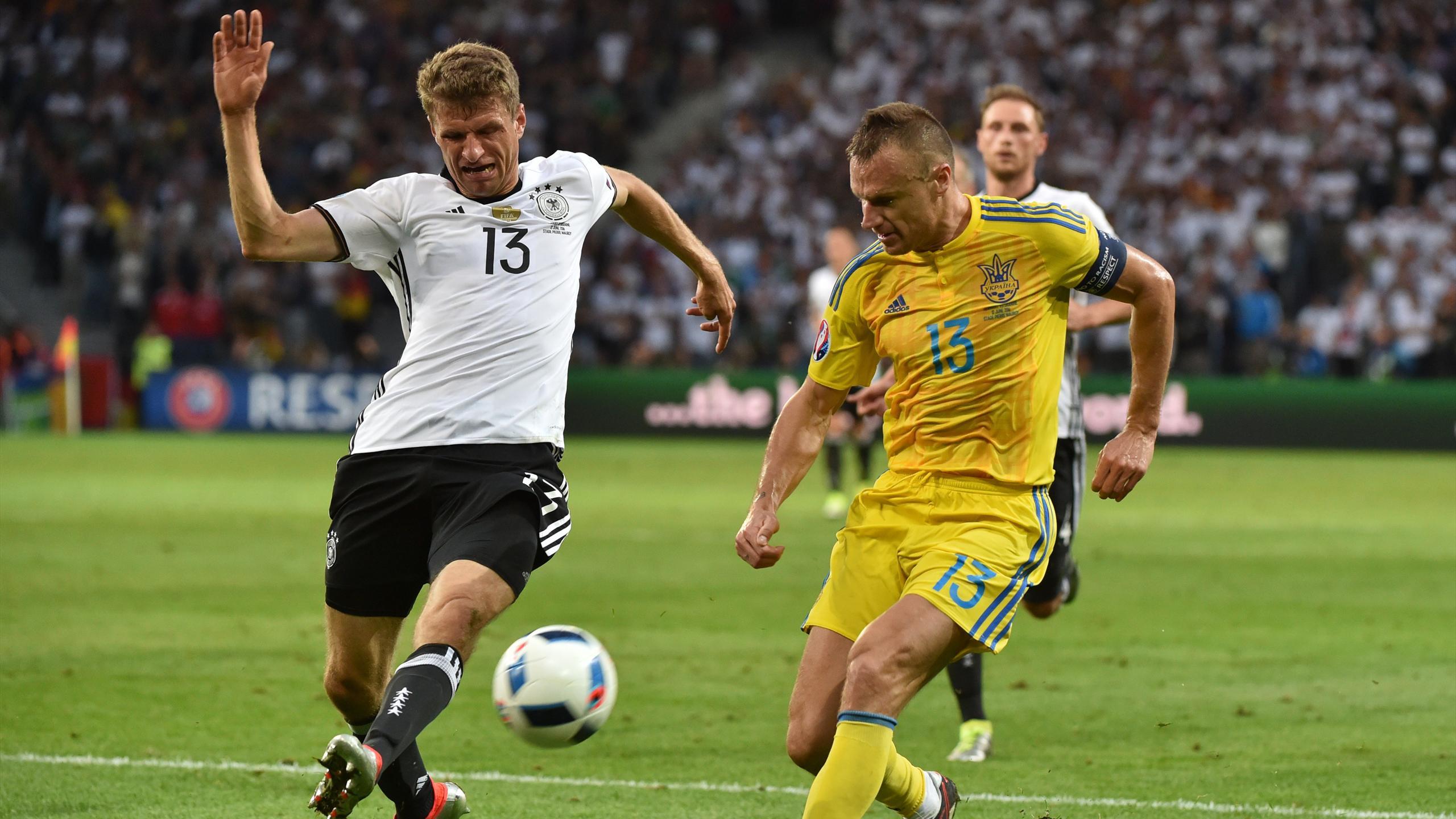 Ukraine's defender Vyacheslav Shevchuk (R) challenges Germany's midfielder Thomas Mueller during the Euro 2016 group C football match between Germany and Ukraine