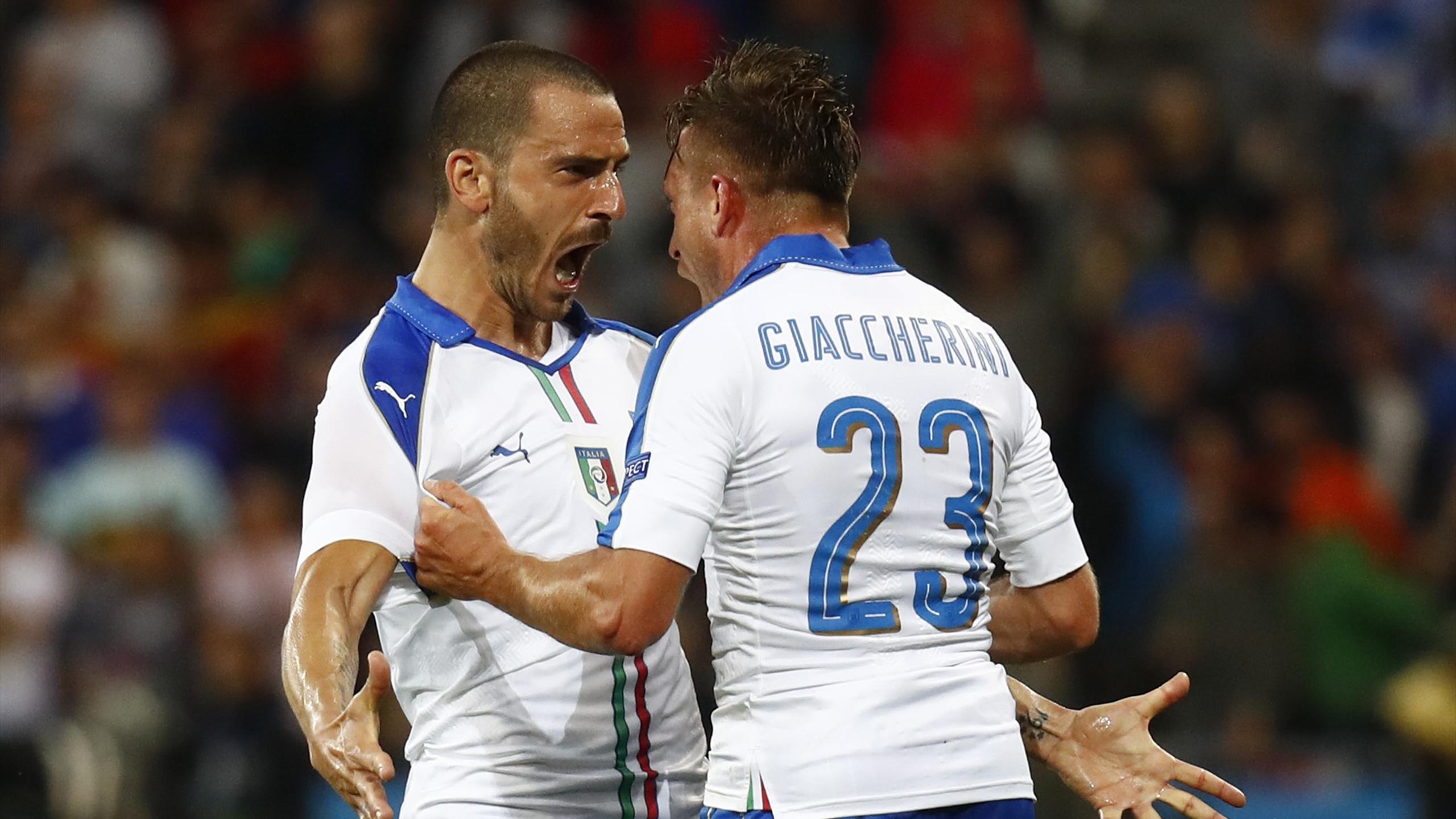 Italy's Emanuele Giaccherini celebrates scoring their first goal with Leonardo Bonucci