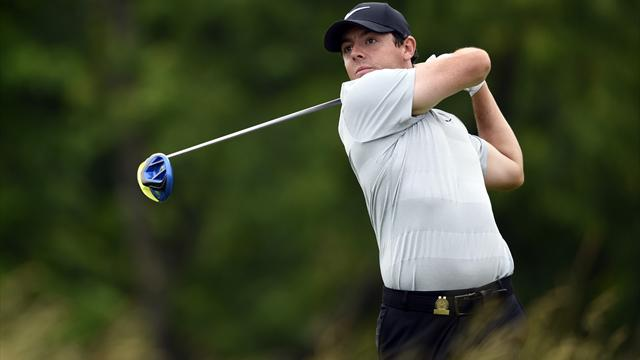 Players struggle with weather delays - but at least Rory saw the football
