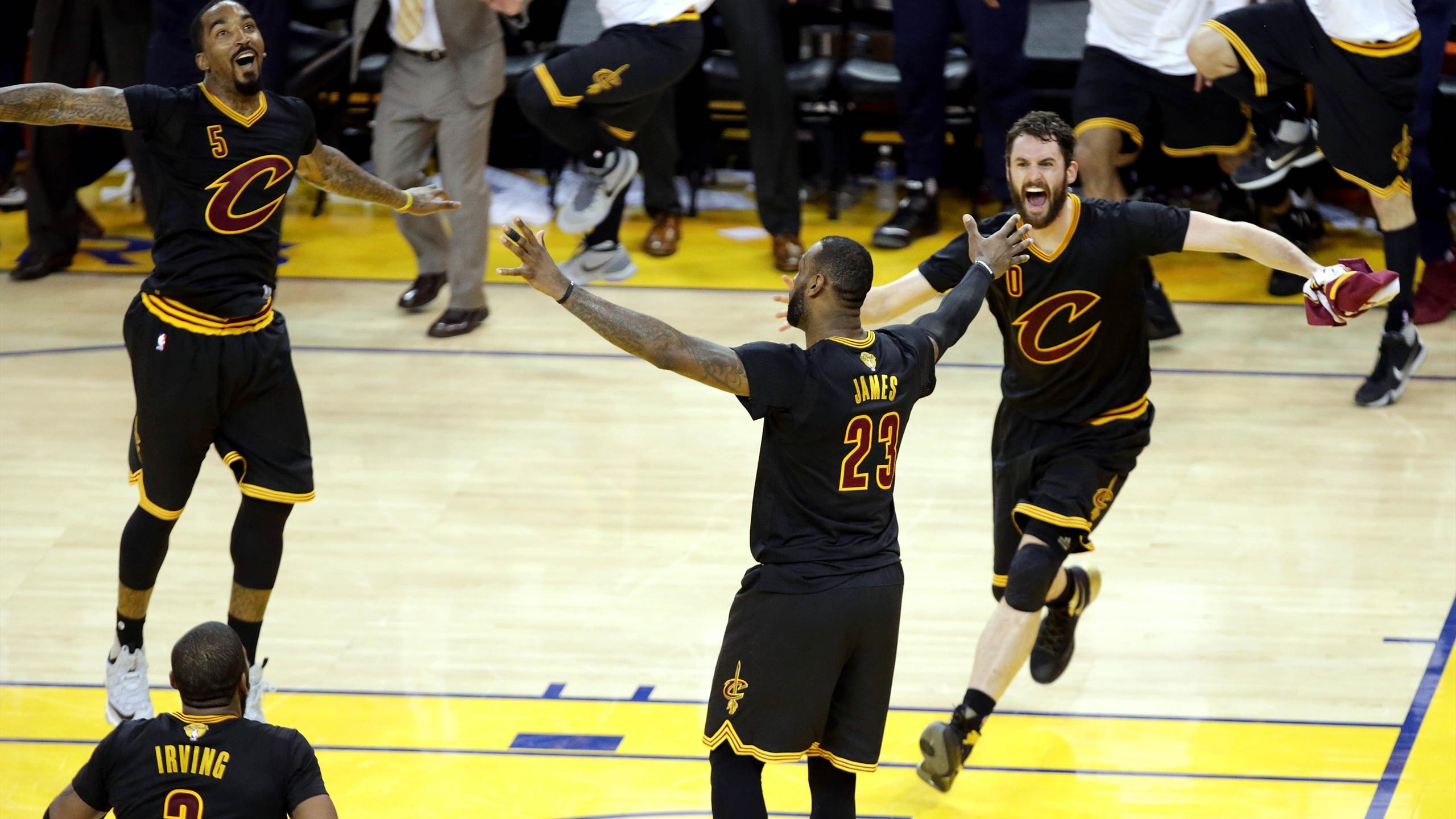 LeBron James celebrates as Cleveland Cavaliers win NBA title