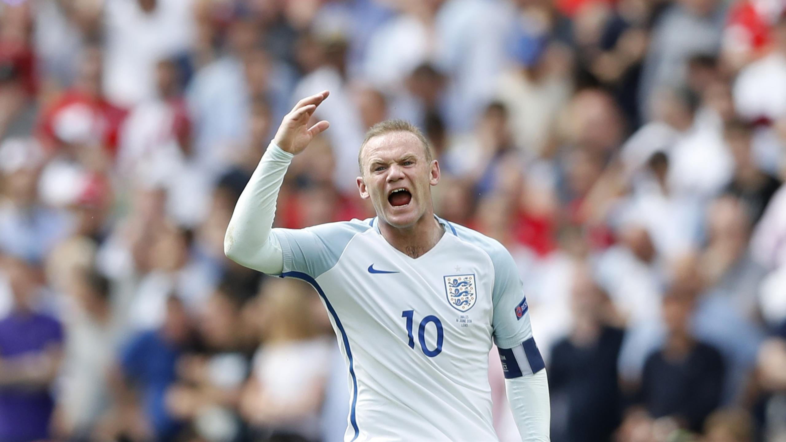 England's Wayne Rooney reacts against Wales