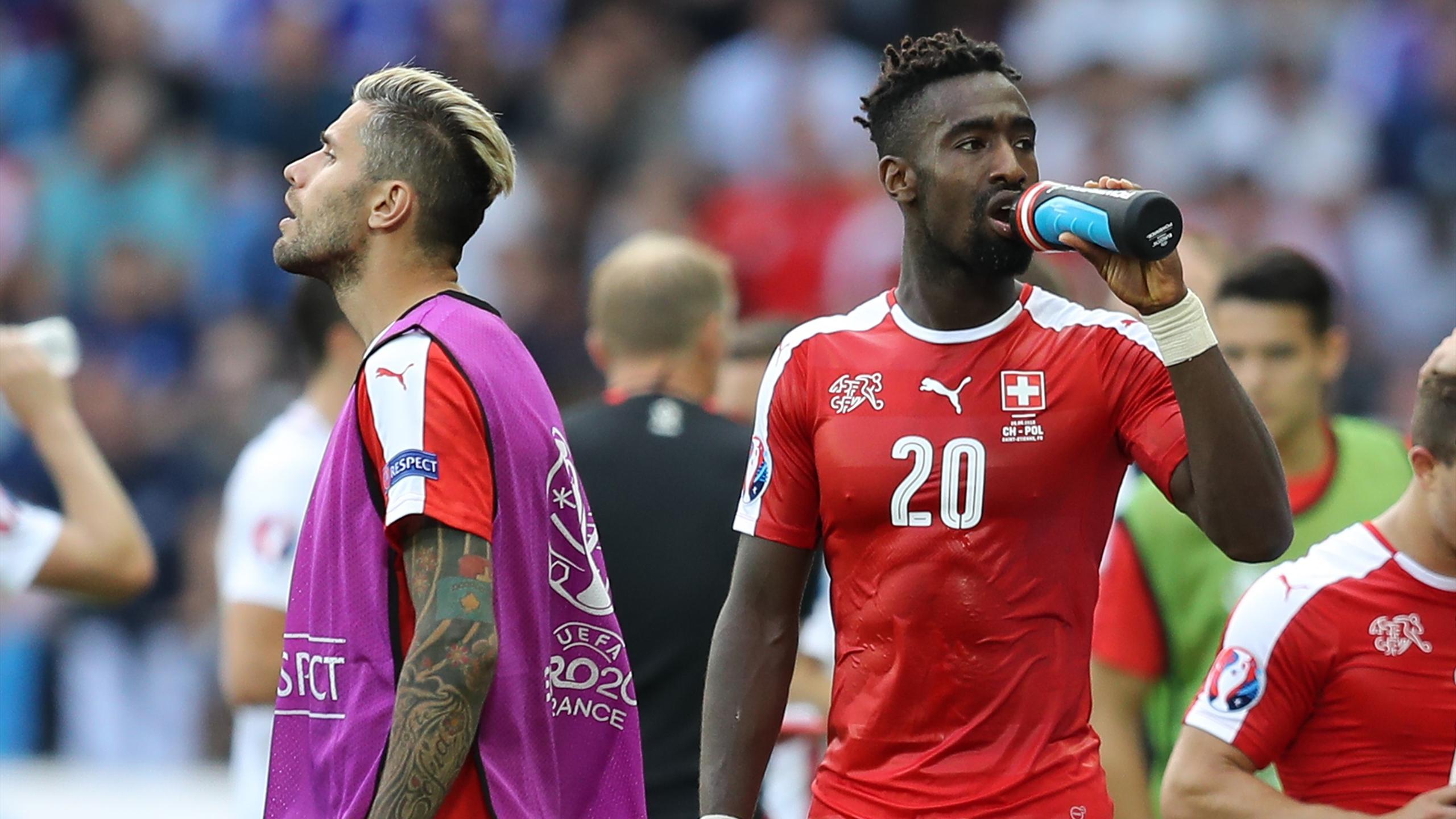 Switzerland's midfielder Valon Behrami and Switzerland's defender Johan Djourou