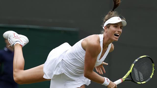 Konta eases through after rain-interrupted match