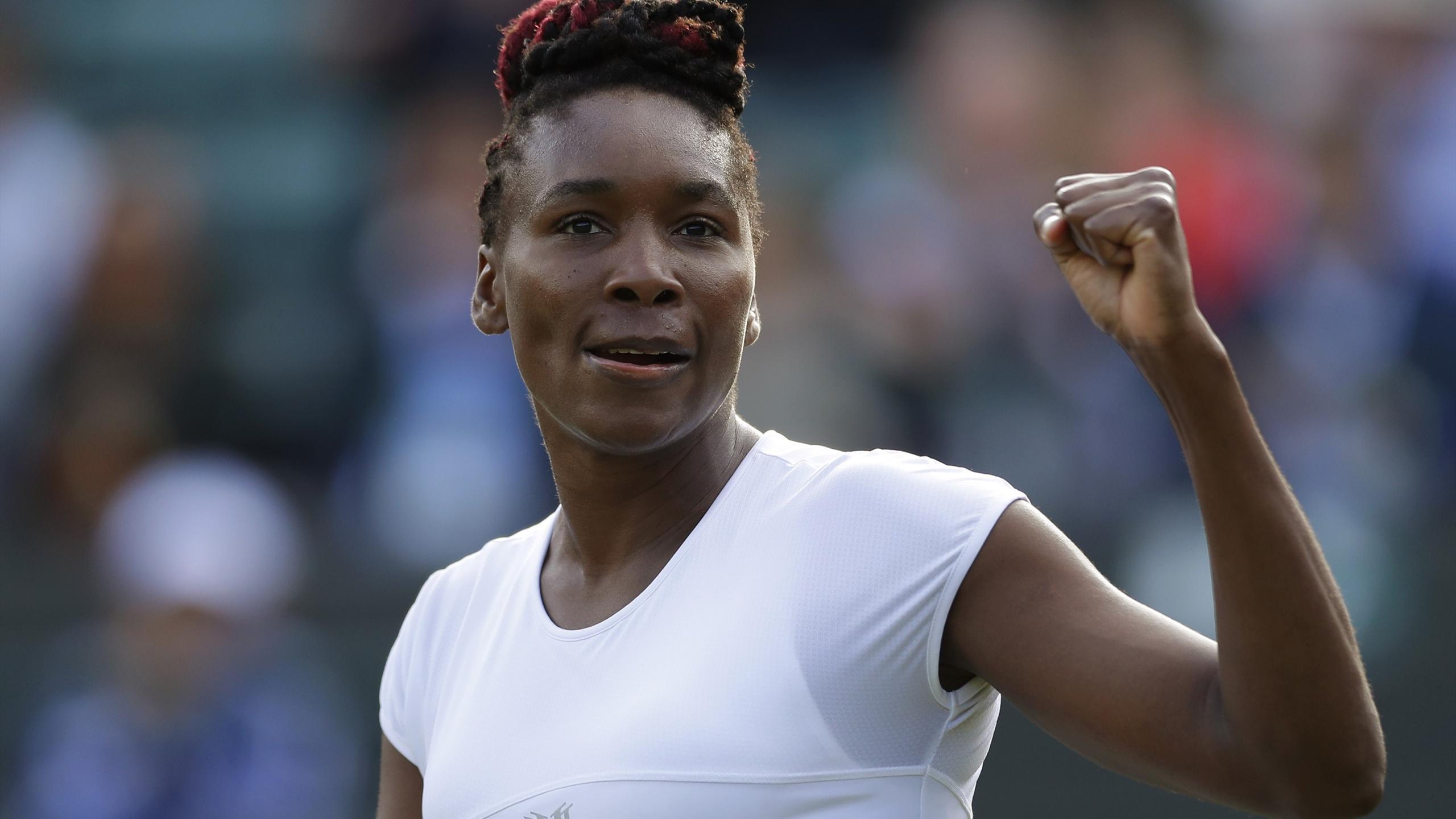 Venus Williams celebrates winning her match against Russia's Daria Kasatkina.