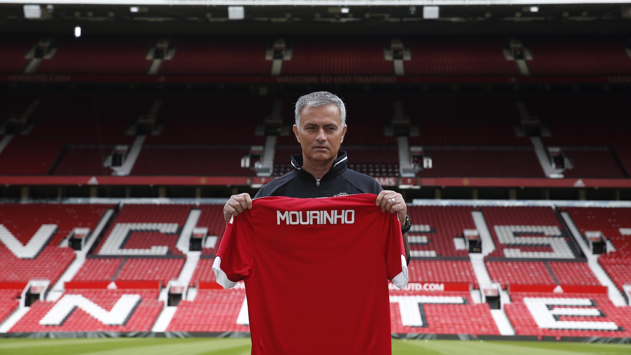 New Manchester United manager Jose Mourinho poses ahead of the press conference