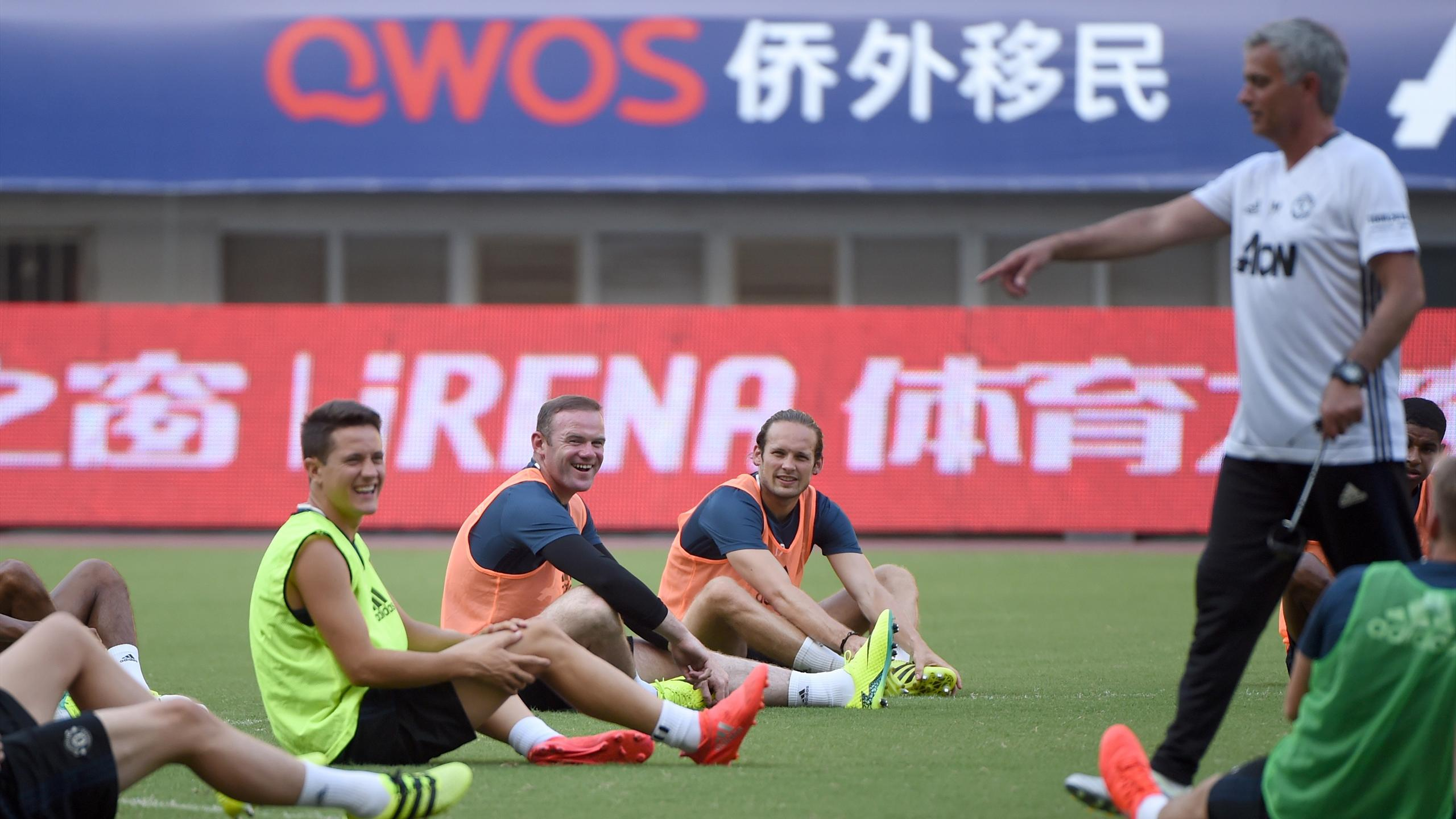 Manchester United's Wayne Rooney (2nd L) smiles during a training session ahead of the 2016 International Champions Cup football match between Manchester United and Dortmund in Shanghai