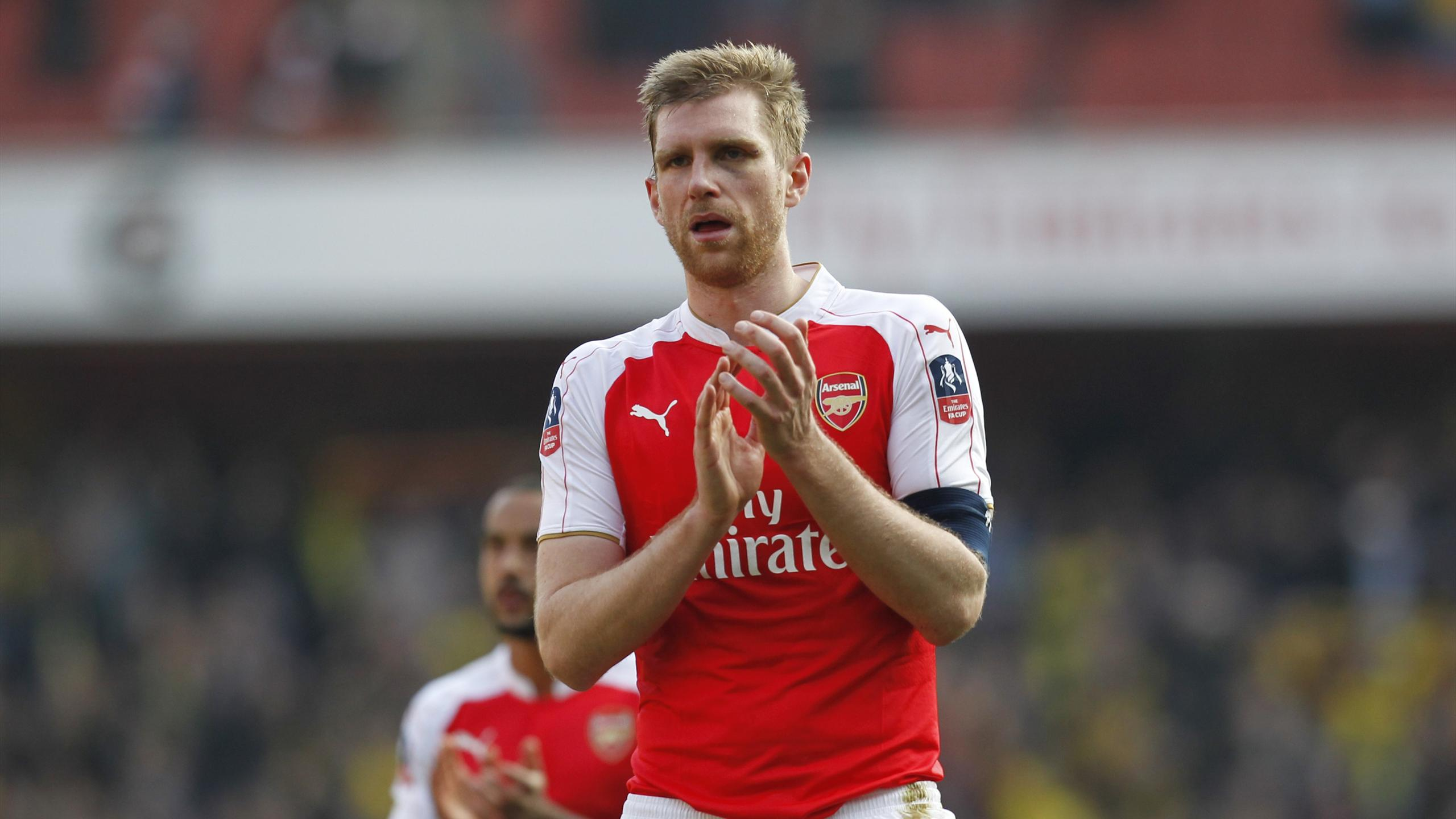 Arsenal's German defender Per Mertesacker appauds supporters