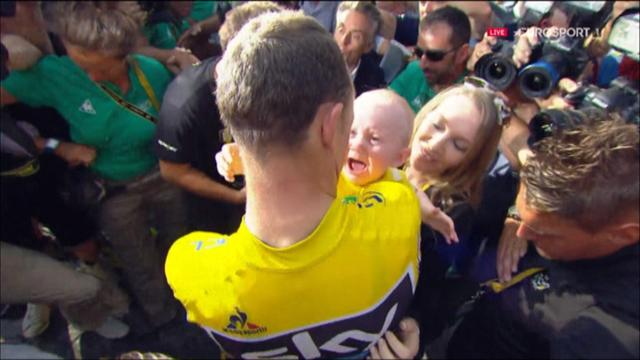 Froome celebrates with his baby son - also in yellow - after Tour triumph