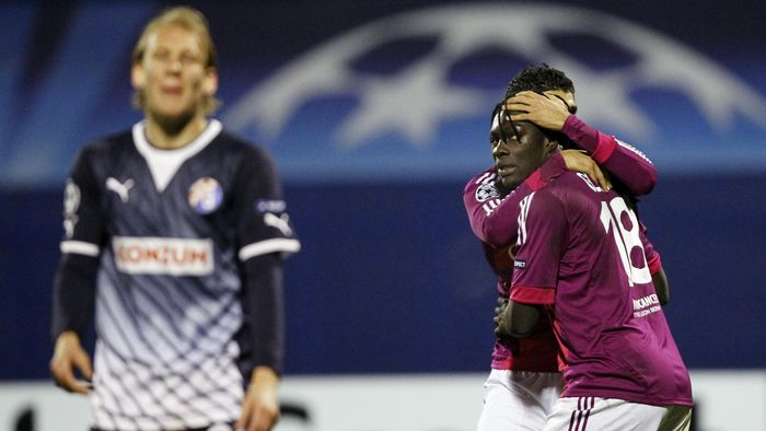 Lyon s Bafetimbi Gomis (R) celebrates after scoring against Dinamo Zagreb  during their Champions League 5c41bde9103