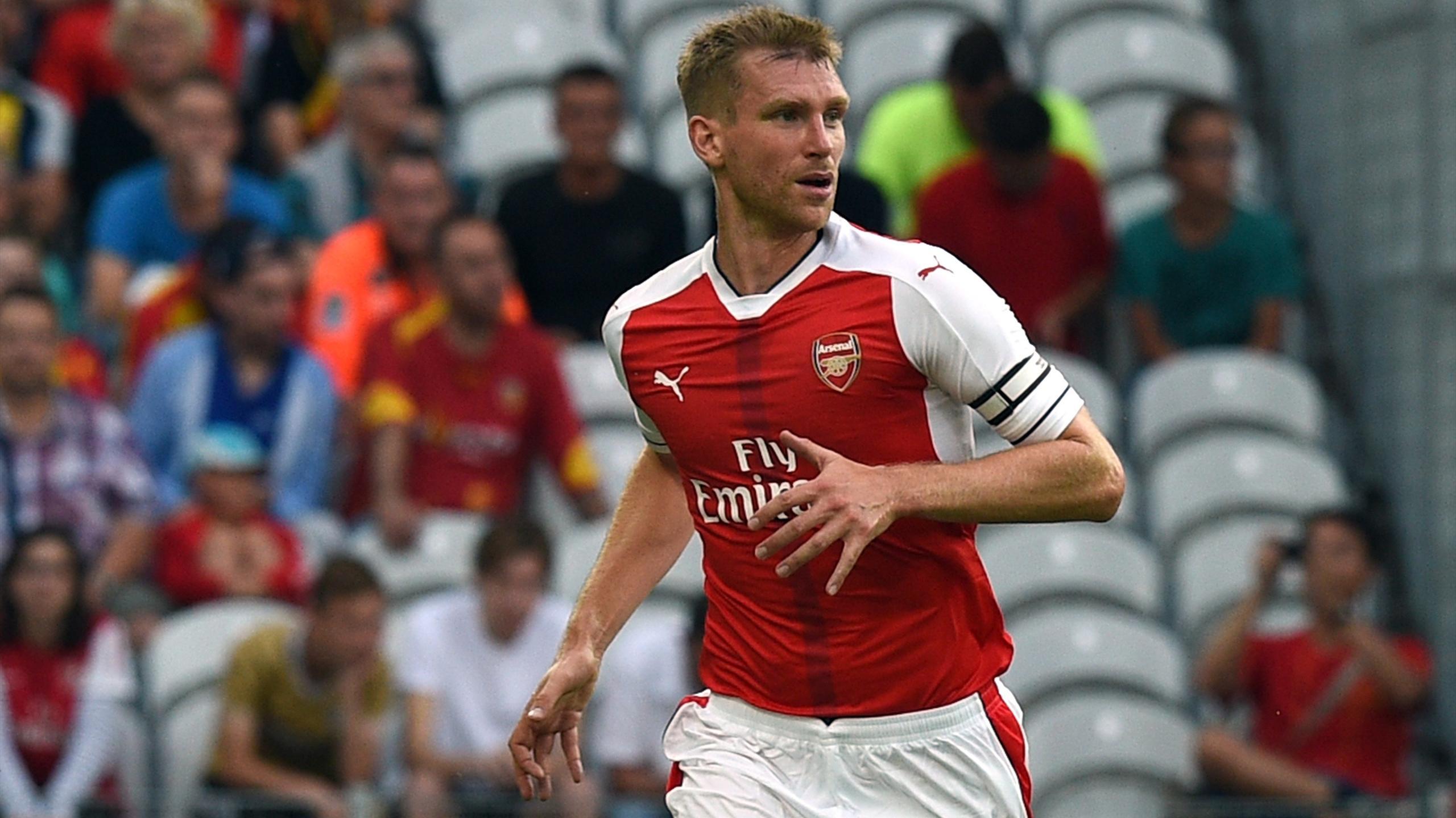 Per Mertesacker in action for Arsenal