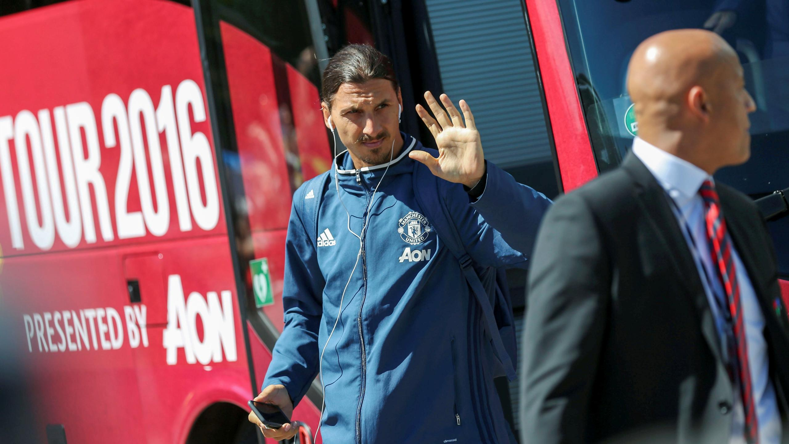 Manchester United's striker Zlatan Ibrahimovic exits the team's bus in front of a hotel in Goteborg, Sweden