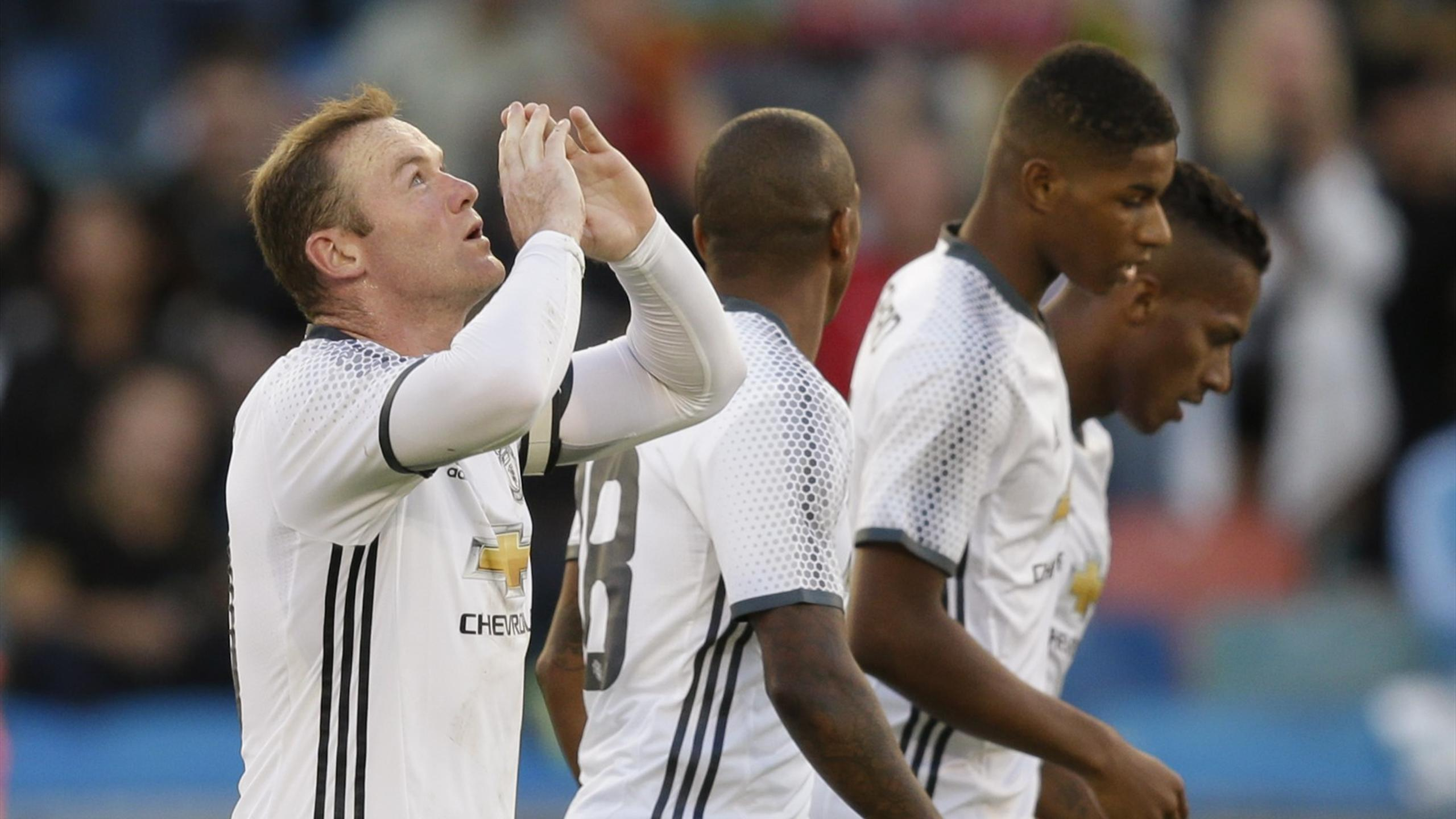 Manchester United's Wayne Rooney celebrates after scoring their third goal from the penalty spot