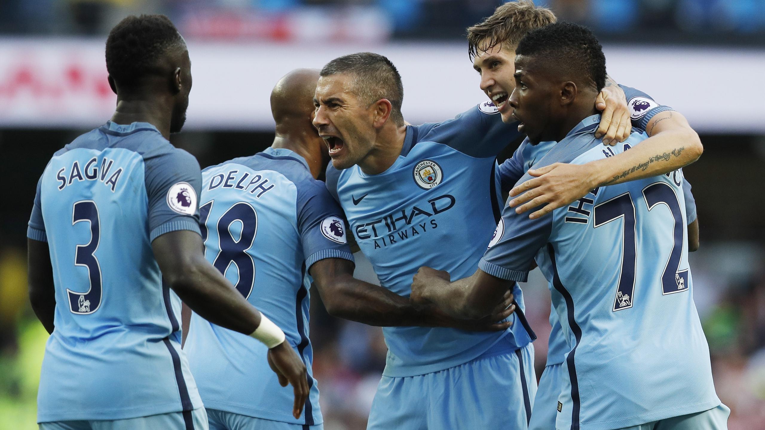 Manchester City's Aleksandar Kolarov celebrates Sunderland's Paddy McNair scoring a own goal and their second
