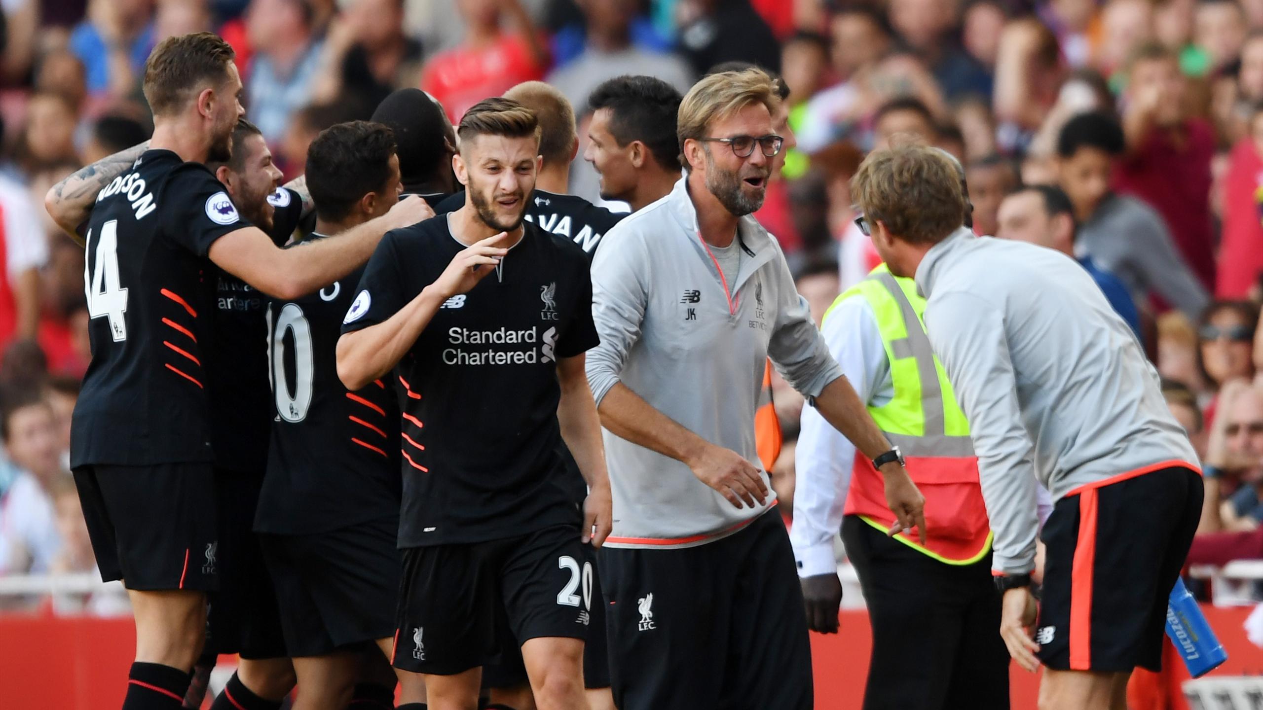 Liverpool's Sadio Mane celebrates scoring their fourth goal with manager Juergen Klopp and teammates