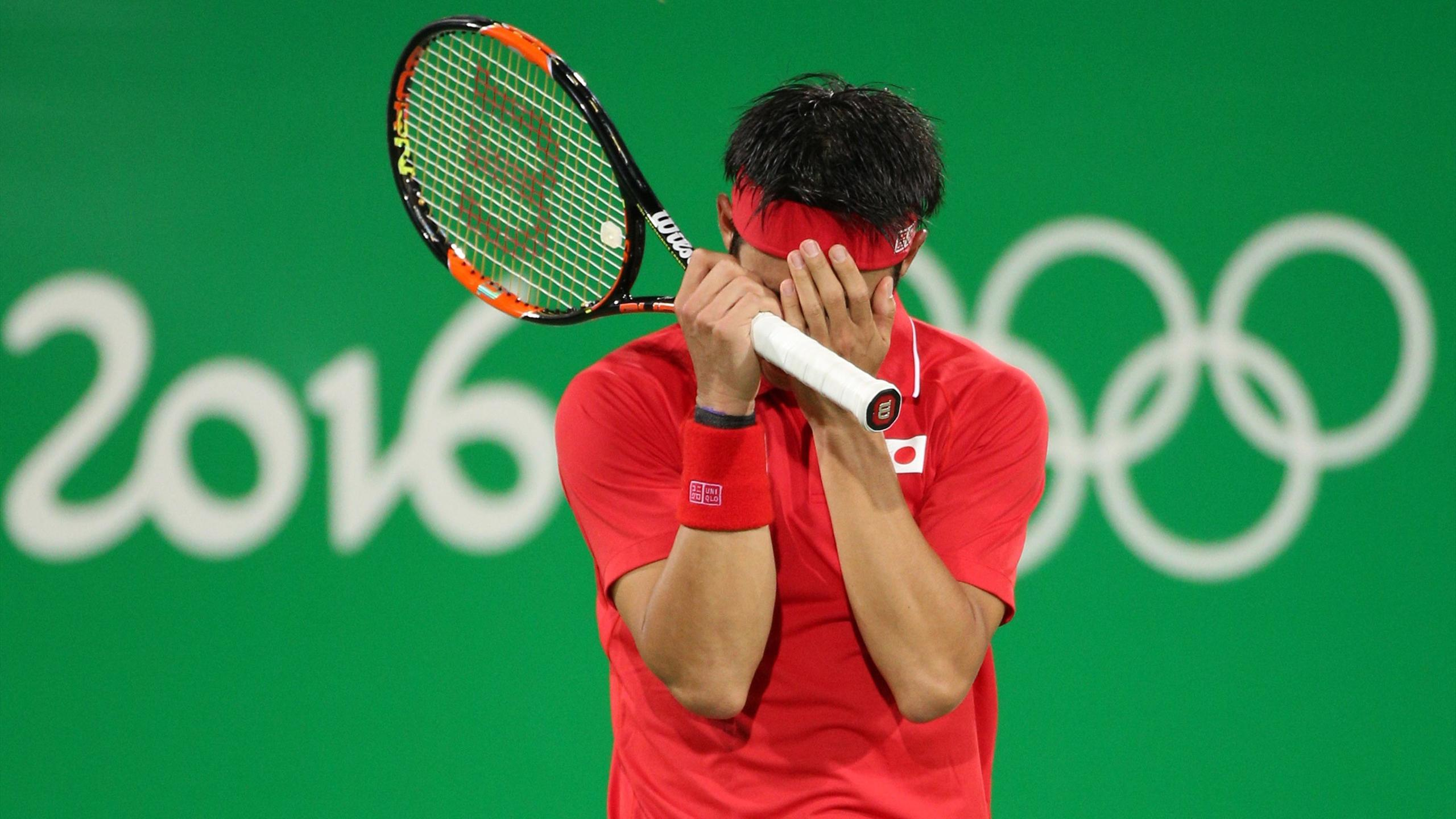 Kei Nishikori (JPN) of Japan celebrates after winning his match against Rafael Nadal to claim the bronze medal