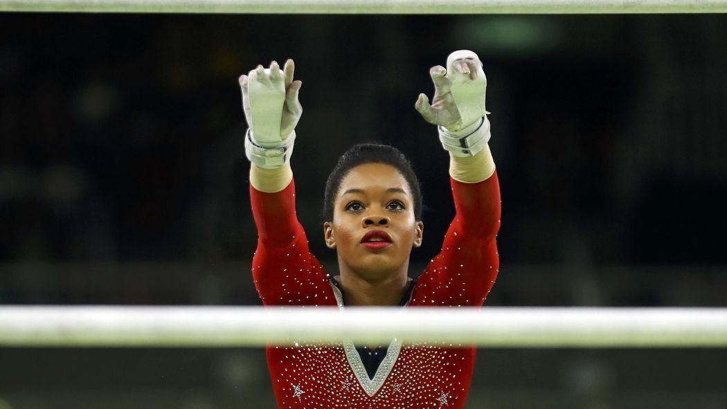 Hurt by 'negativity,' Gabby Douglas struggles on bars - Rio