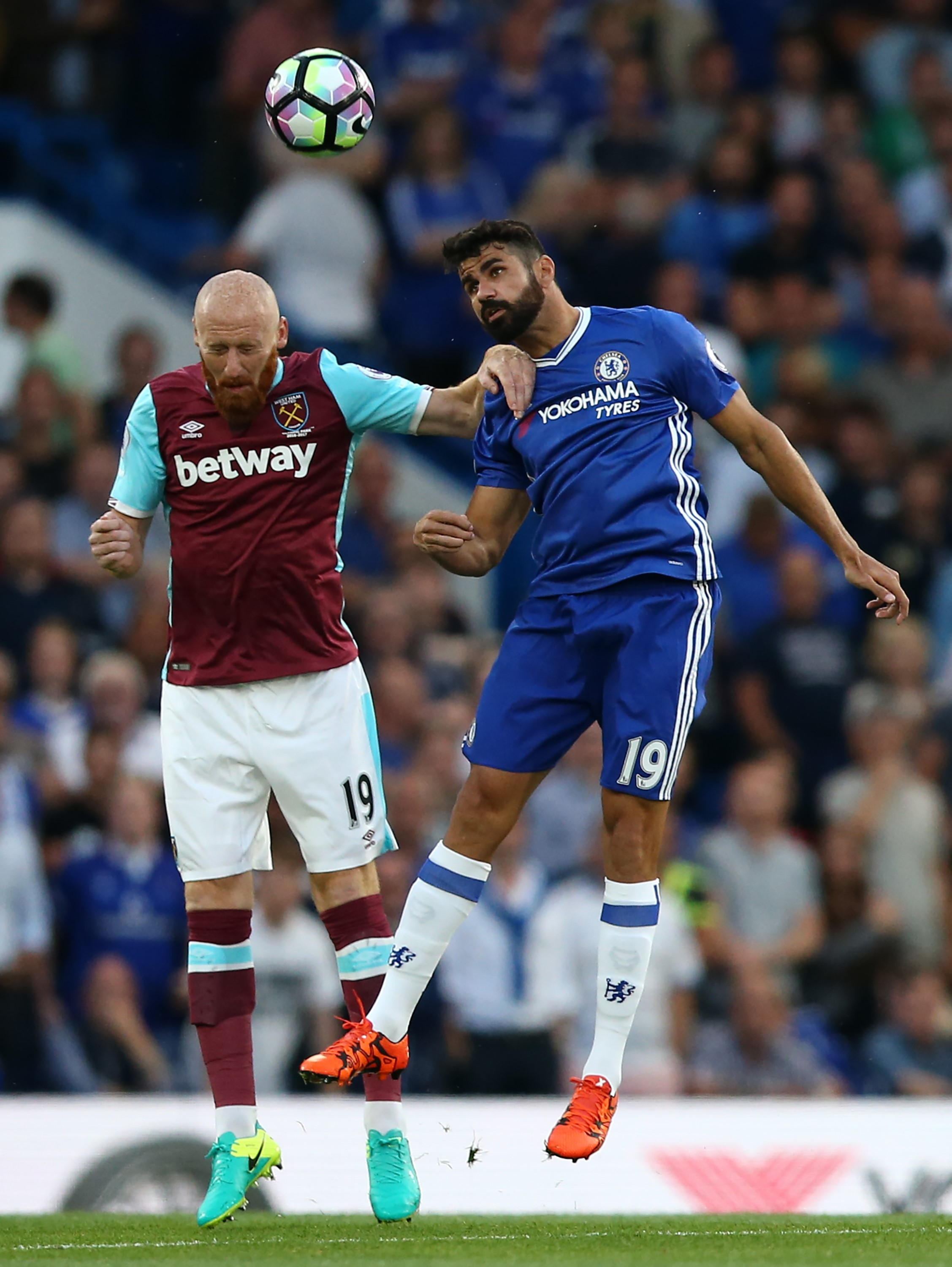 West Ham United's Welsh defender James Collins (L) vies with Chelsea's Brazilian-born Spanish striker Diego Costa during the English Premier League football match between Chelsea and West Ham United at Stamford Bridge in London on August 15, 2016.