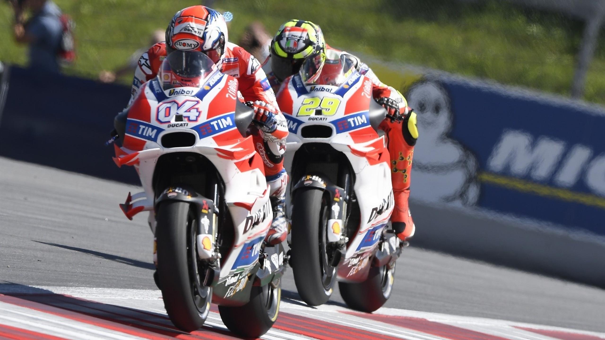 Andrea Dovizioso et Andrea Iannone (Ducati Team) during Austrian GP 2016