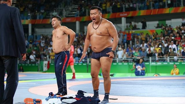 PICTURES: Mongolian coaches strip in arena to protest decision