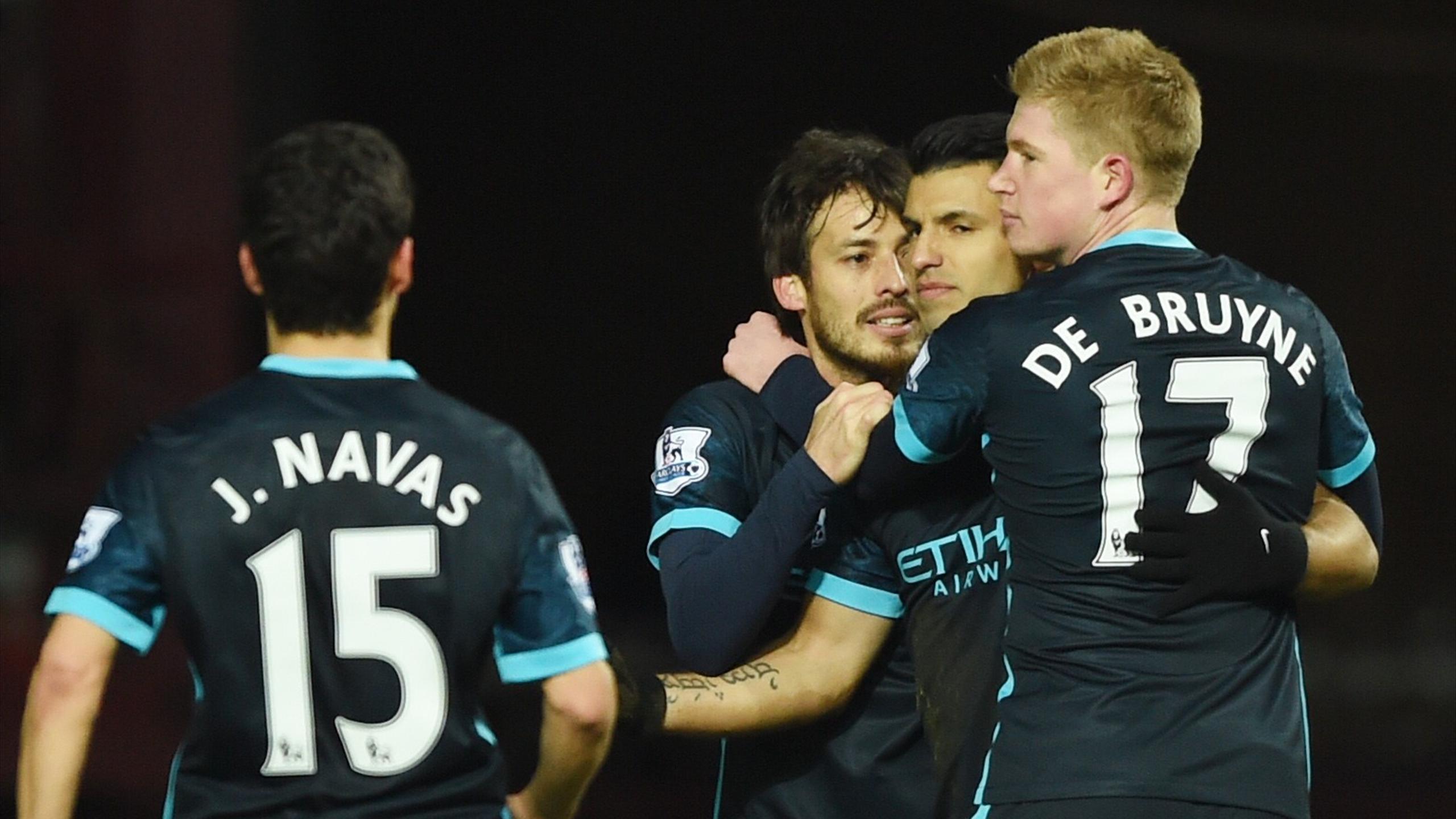 Manchester City's Sergio Aguero celebrates scoring their first goal with Kevin de Bruyne, David Silva and Jesus Navas