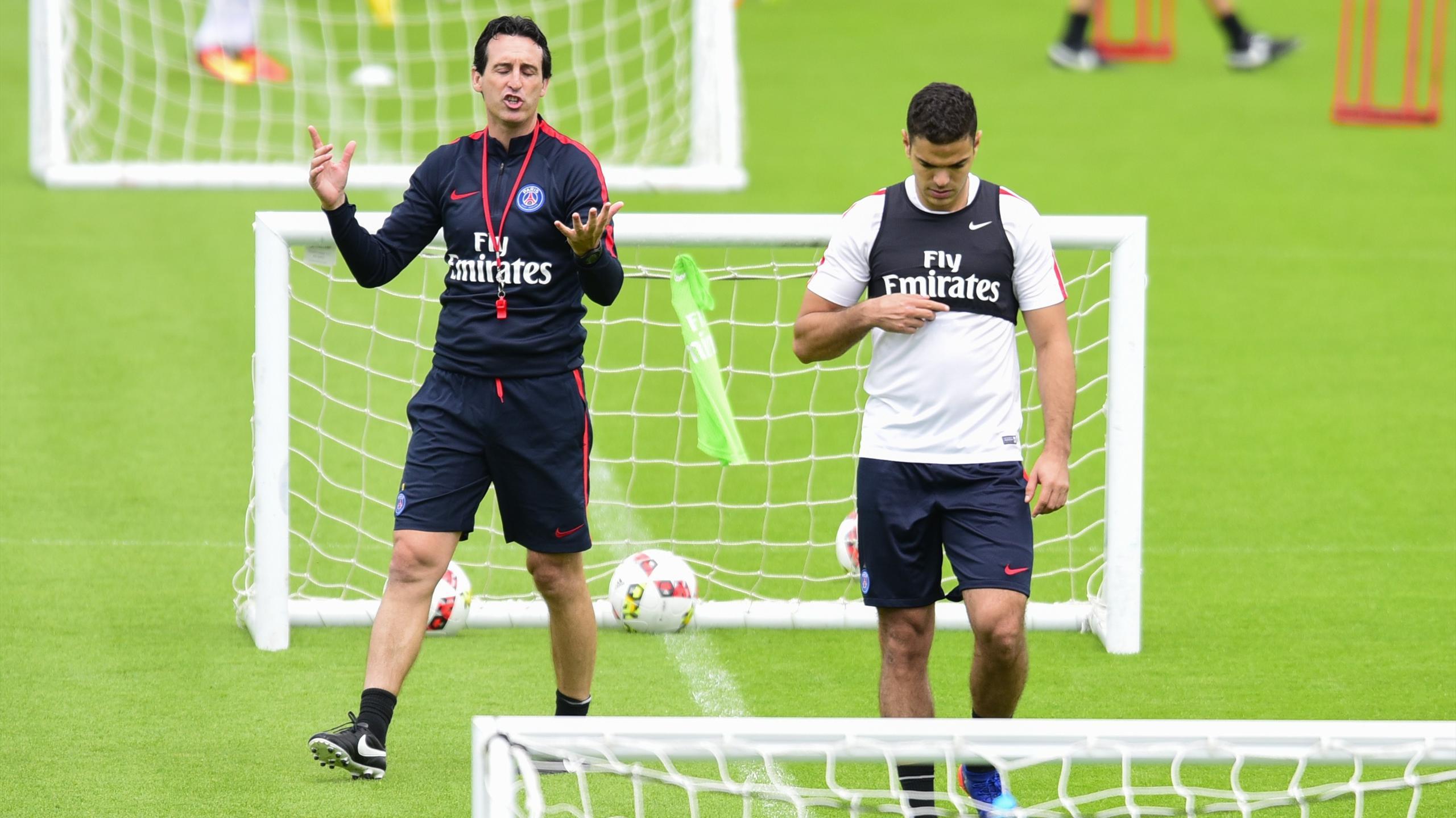Unai Emery et Hatem Ben Arfa lors d'un entraînement du PSG