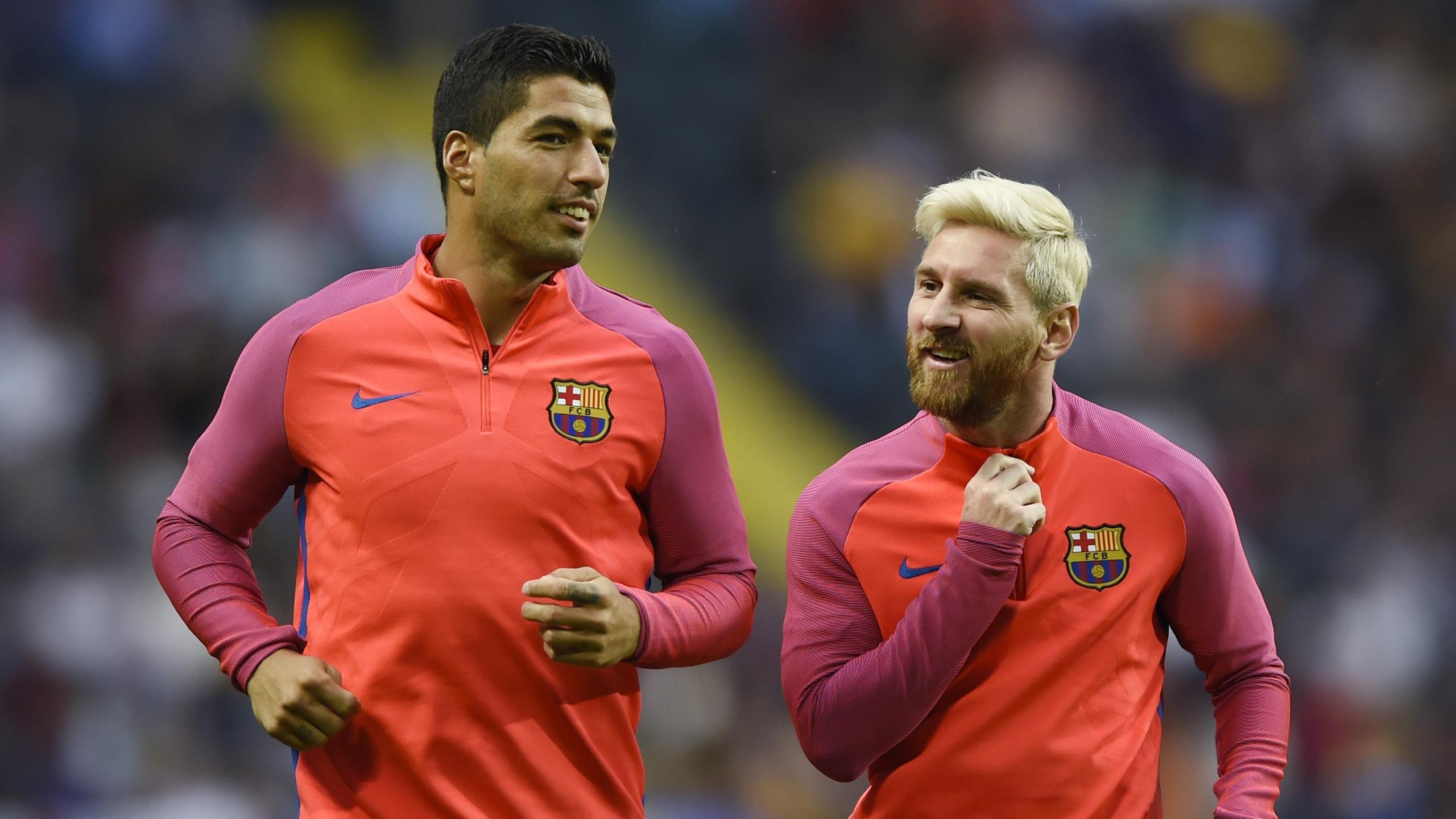 Barcelona's Luis Suarez and Lionel Messi during the warm up before the match