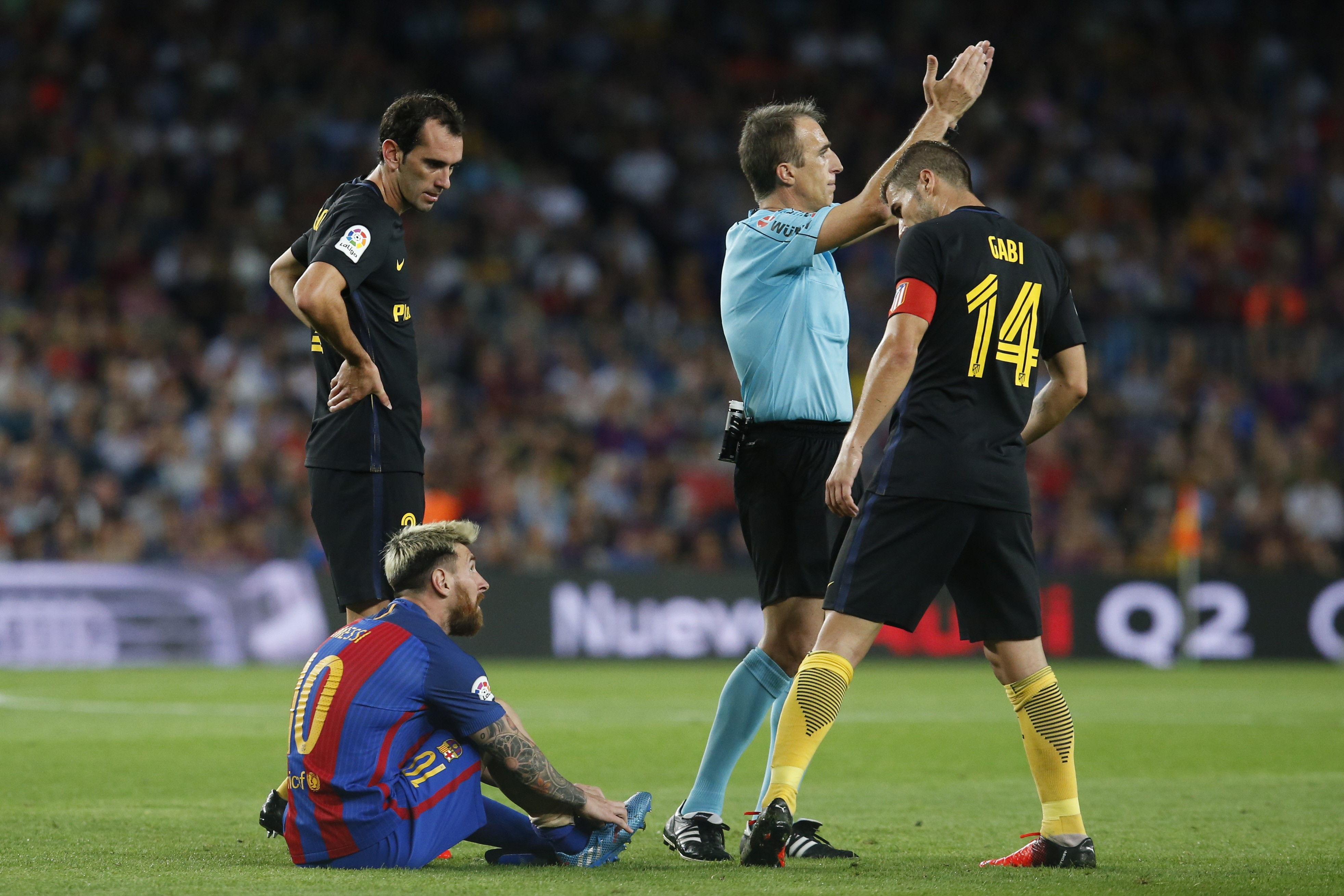 Barcelona's Argentinian forward Lionel Messi sits on the ground