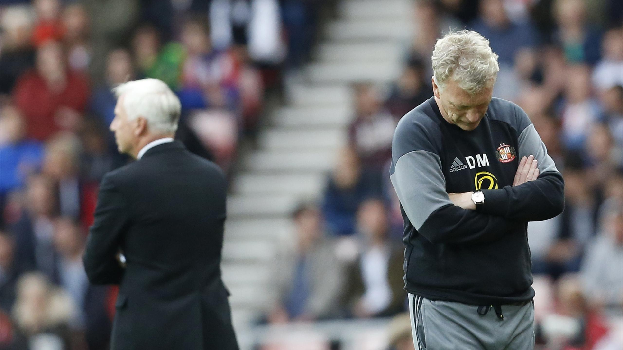 Sunderland manager David Moyes looks dejected as Crystal Palace manager Alan Pardew looks on