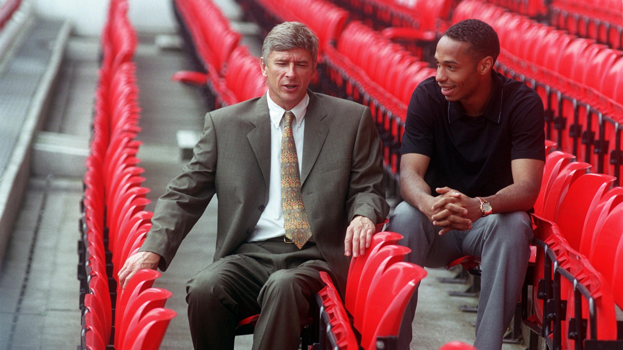 Arsenal's Thierry Henry & his new manager Arsene Wenger pose for photographs, sitting in the stand at Highbury