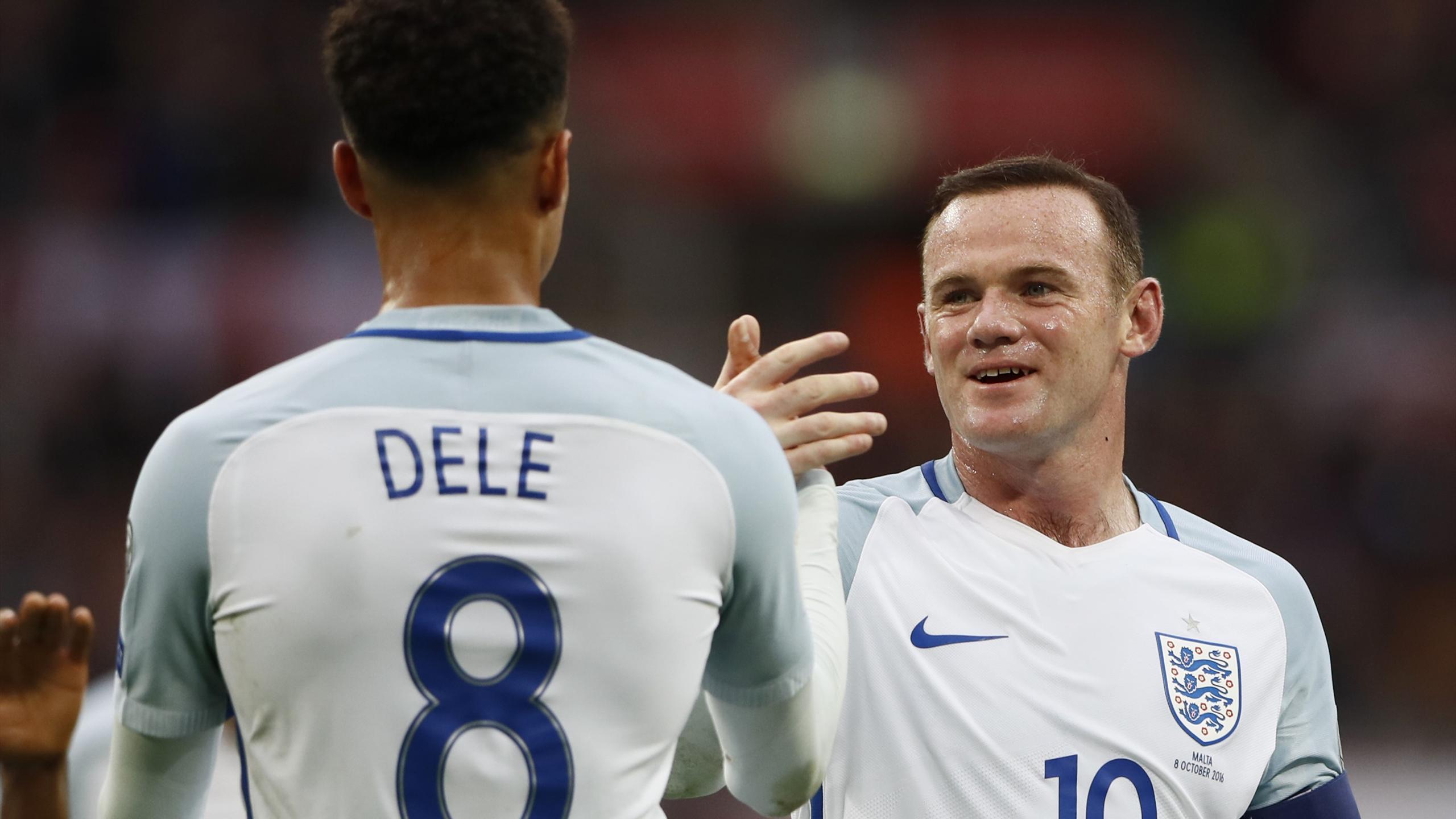 England's Dele Alli celebrates scoring their second goal with Wayne Rooney