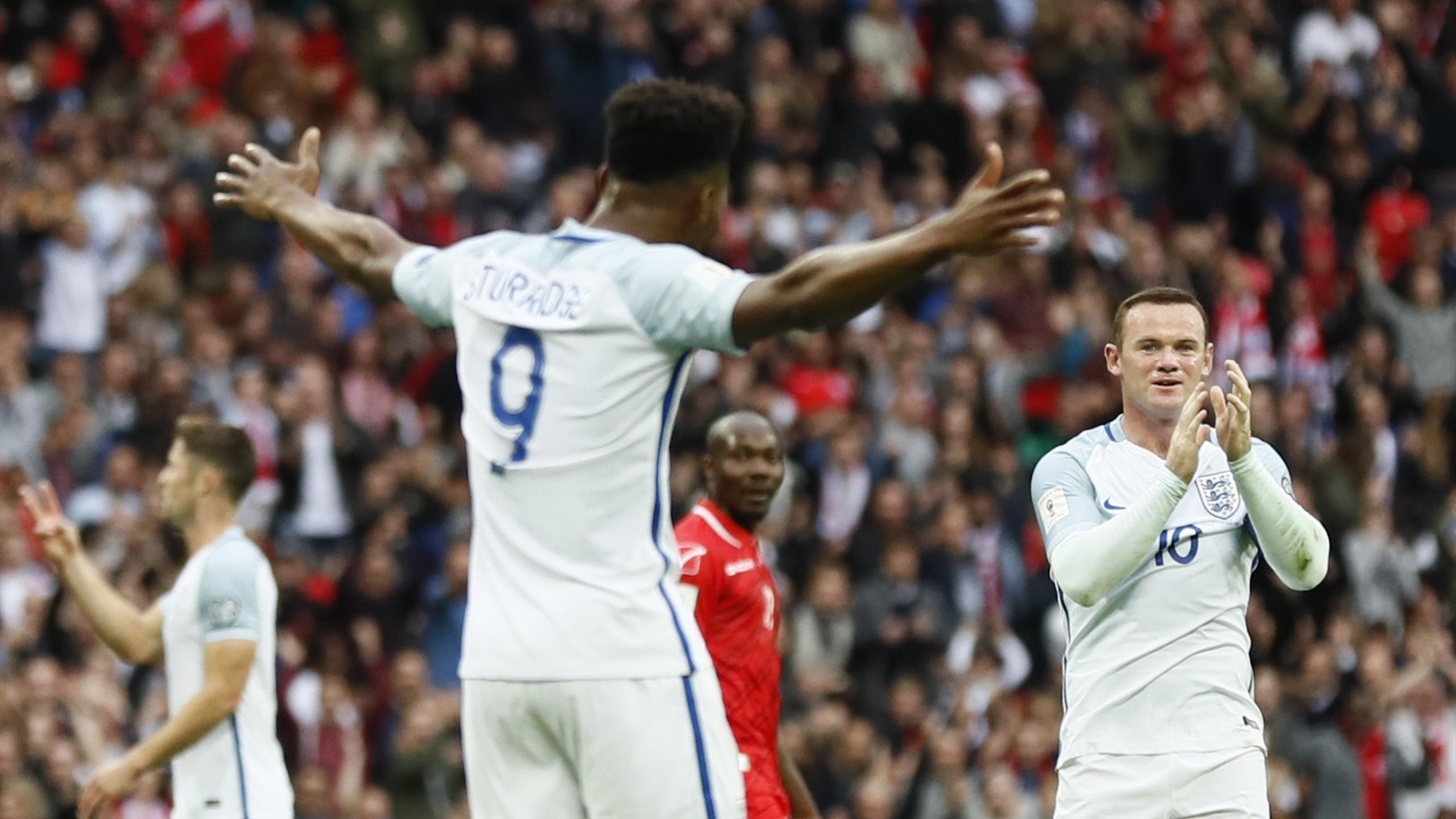 England's Daniel Sturridge celebrates scoring their first goal with Wayne Rooney