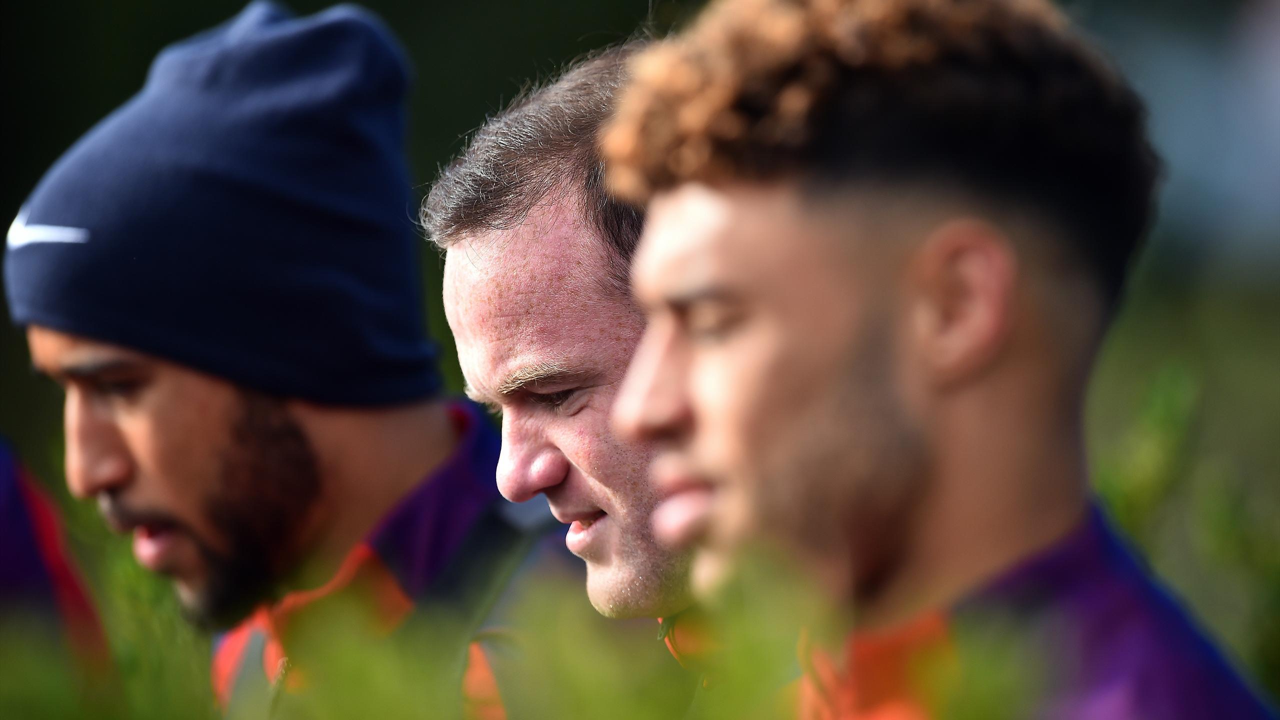 England's striker Wayne Rooney (C) attends a team training at Tottenham Hotspur's football training facility in Enfield