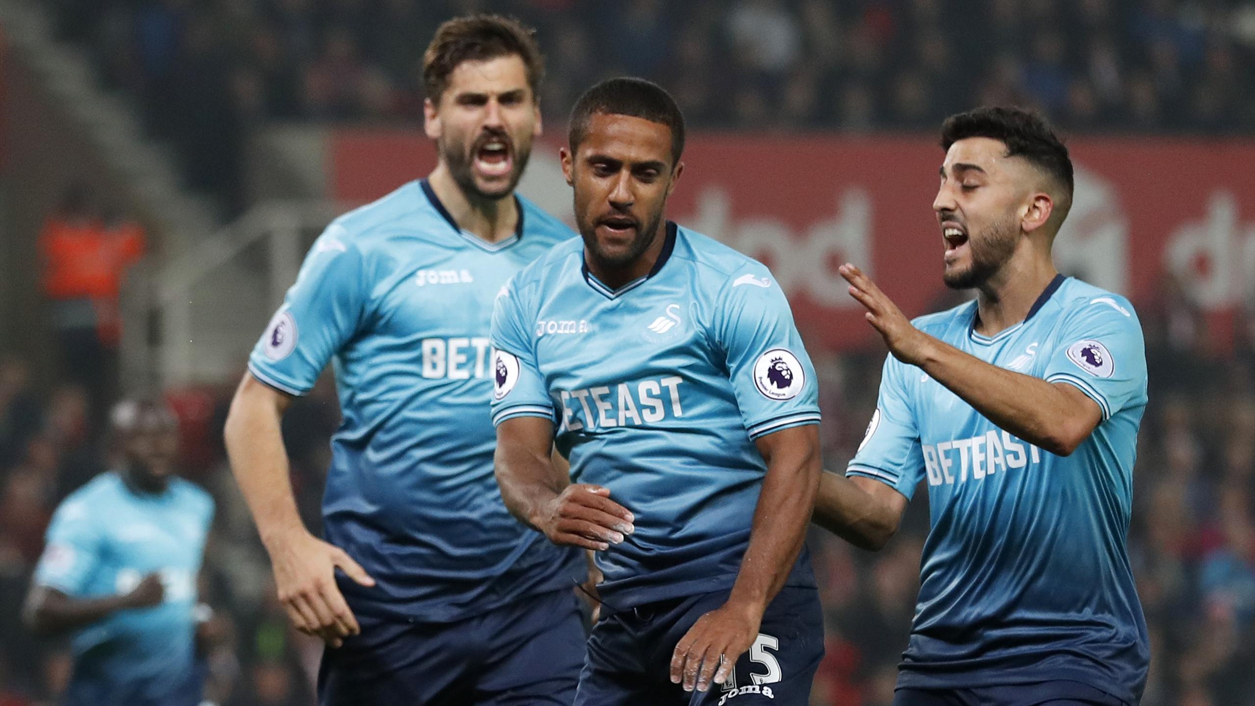 Swansea City's Wayne Routledge celebrates scoring against Stoke