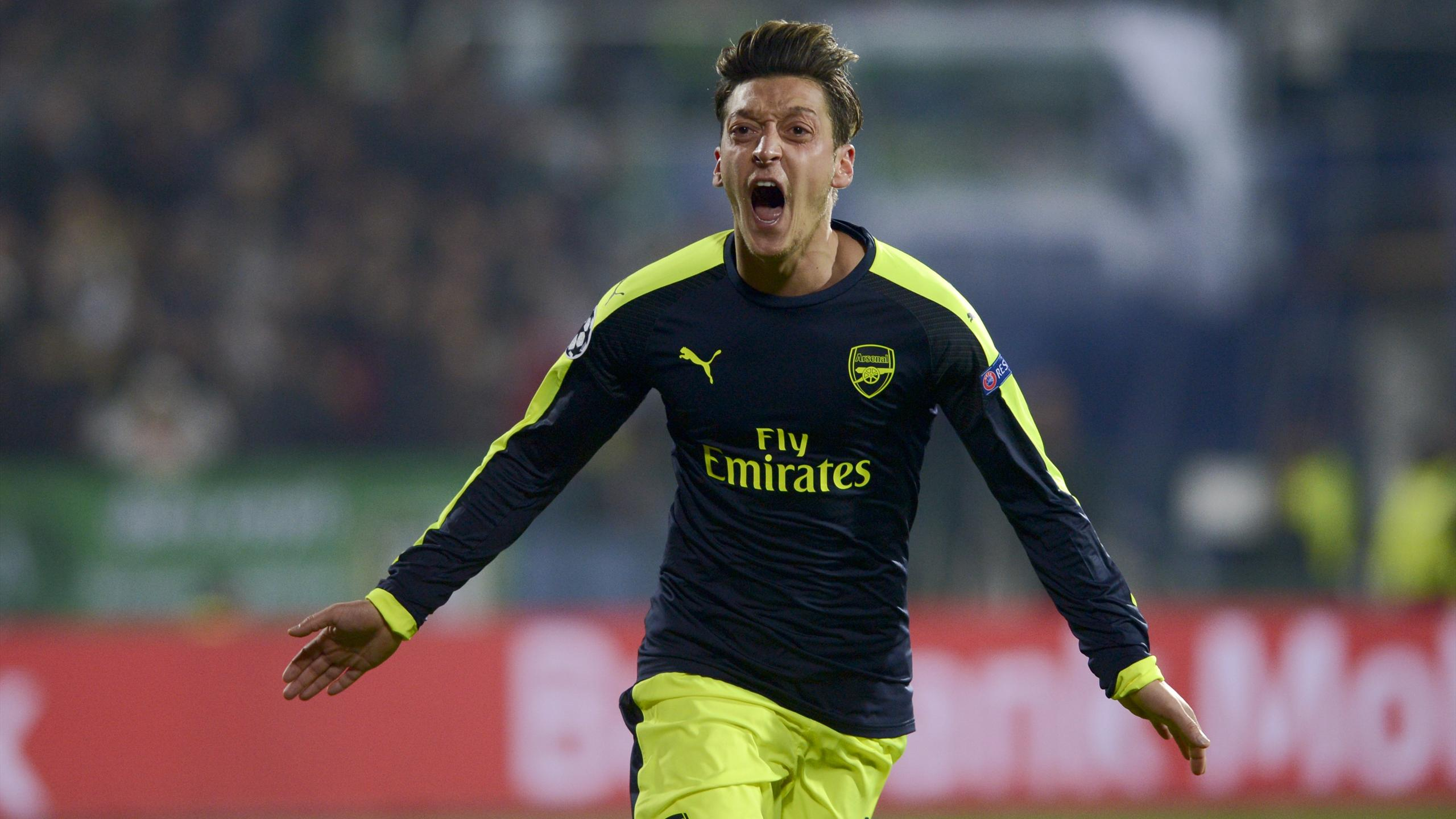 Arsenal's midfielder Mesut Özil celebrates after scoring a goal during the UEFA Champions League Group A football match between PFC Ludogorets and Arsenal, on November 1, 2016