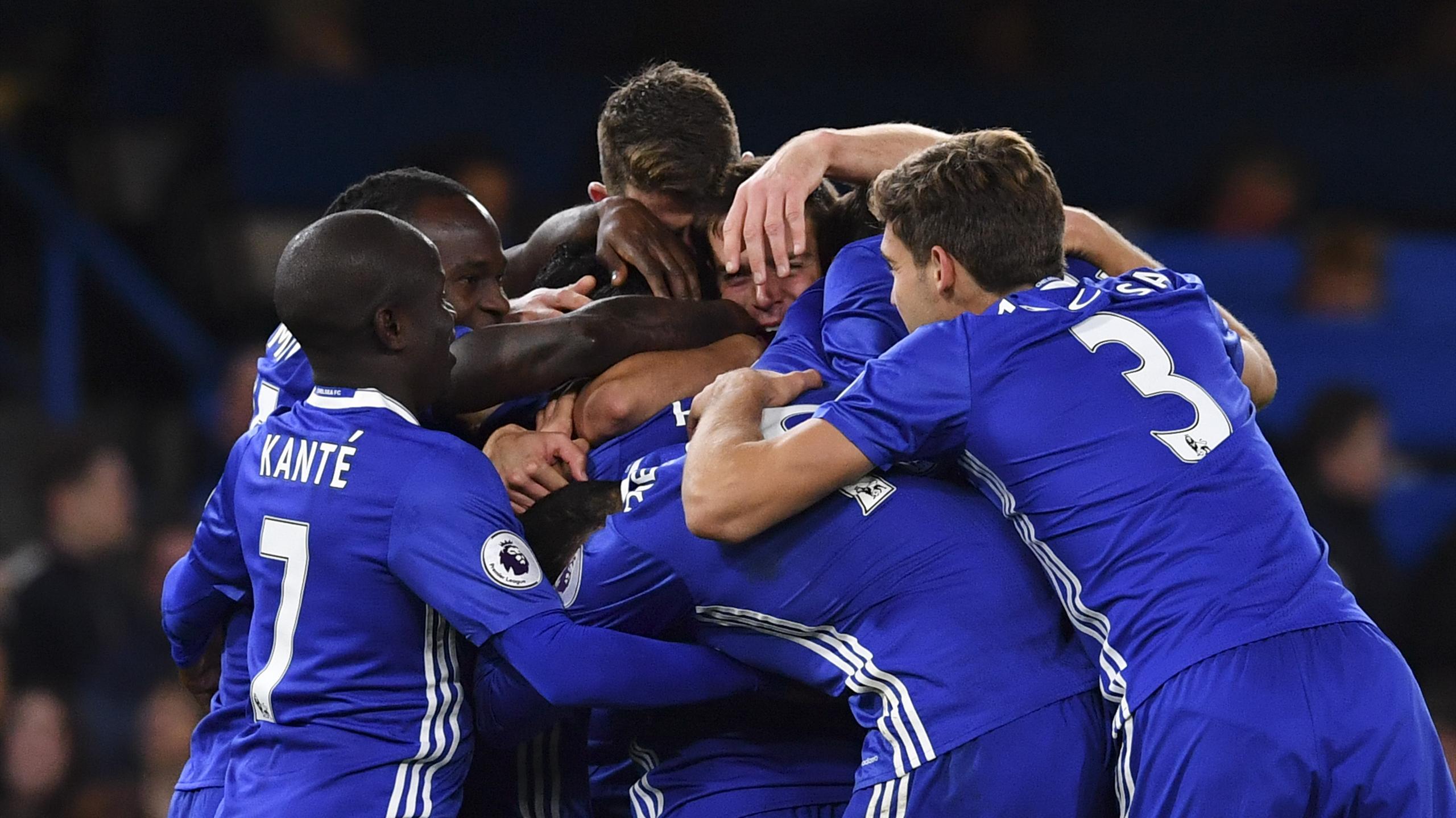 Chelsea's Belgian midfielder Eden Hazard celebrates with teammates