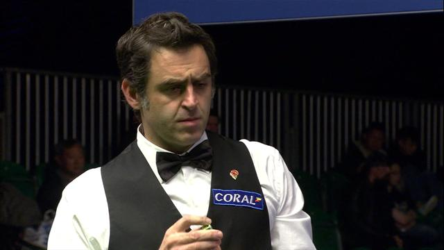 Ronnie releases red on cushion with genius shot, pots it and wins frame