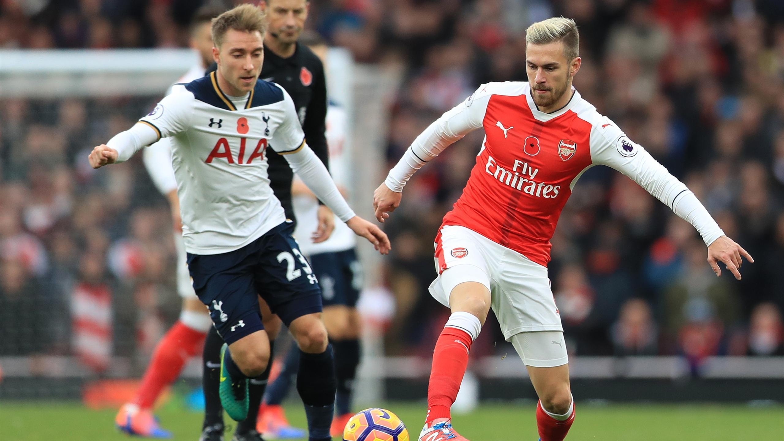 Tottenham Hotspur's Christian Eriksen (left) and Arsenal's Aaron Ramsey