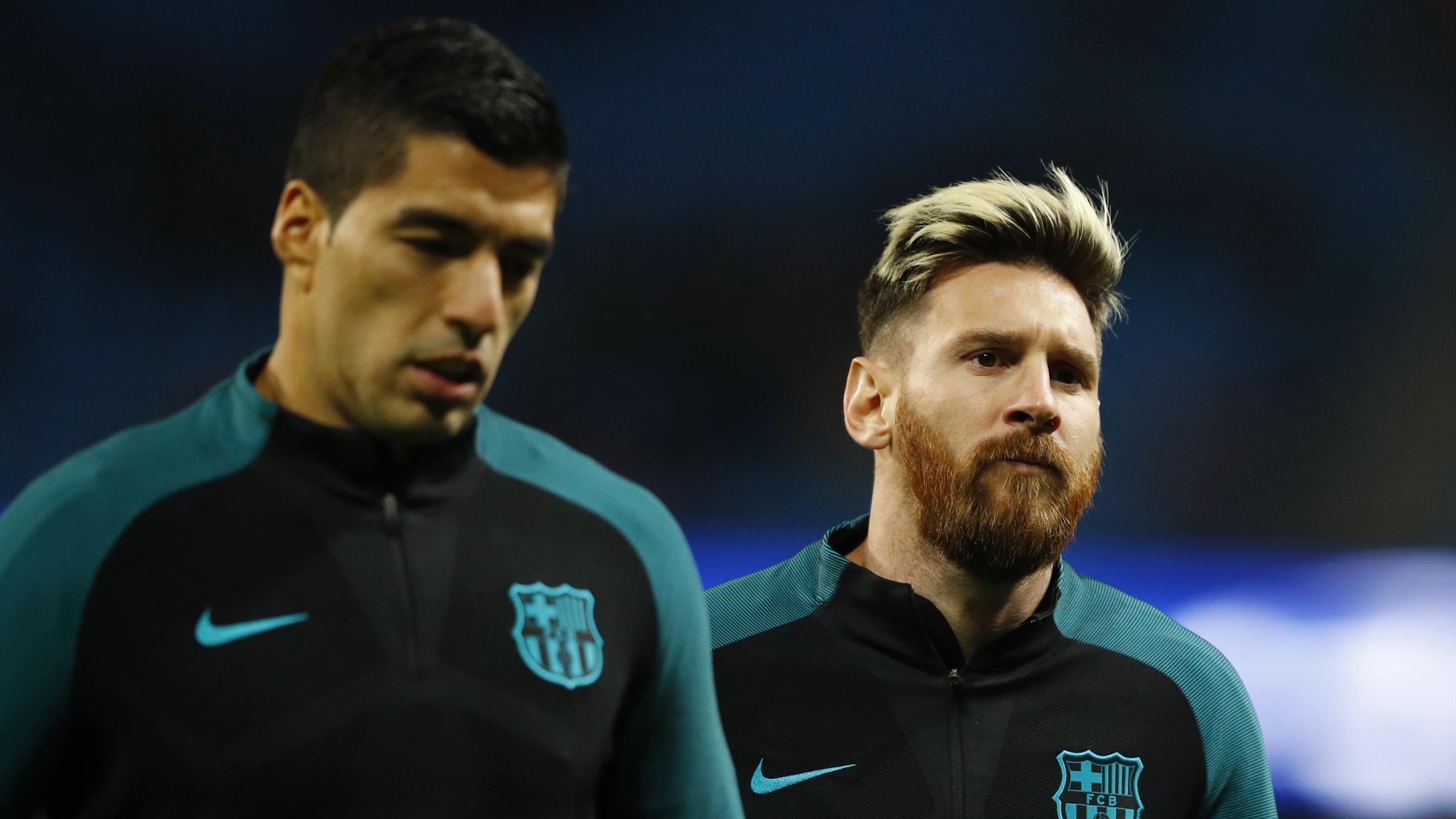 Barcelona's Luis Suarez and Lionel Messi