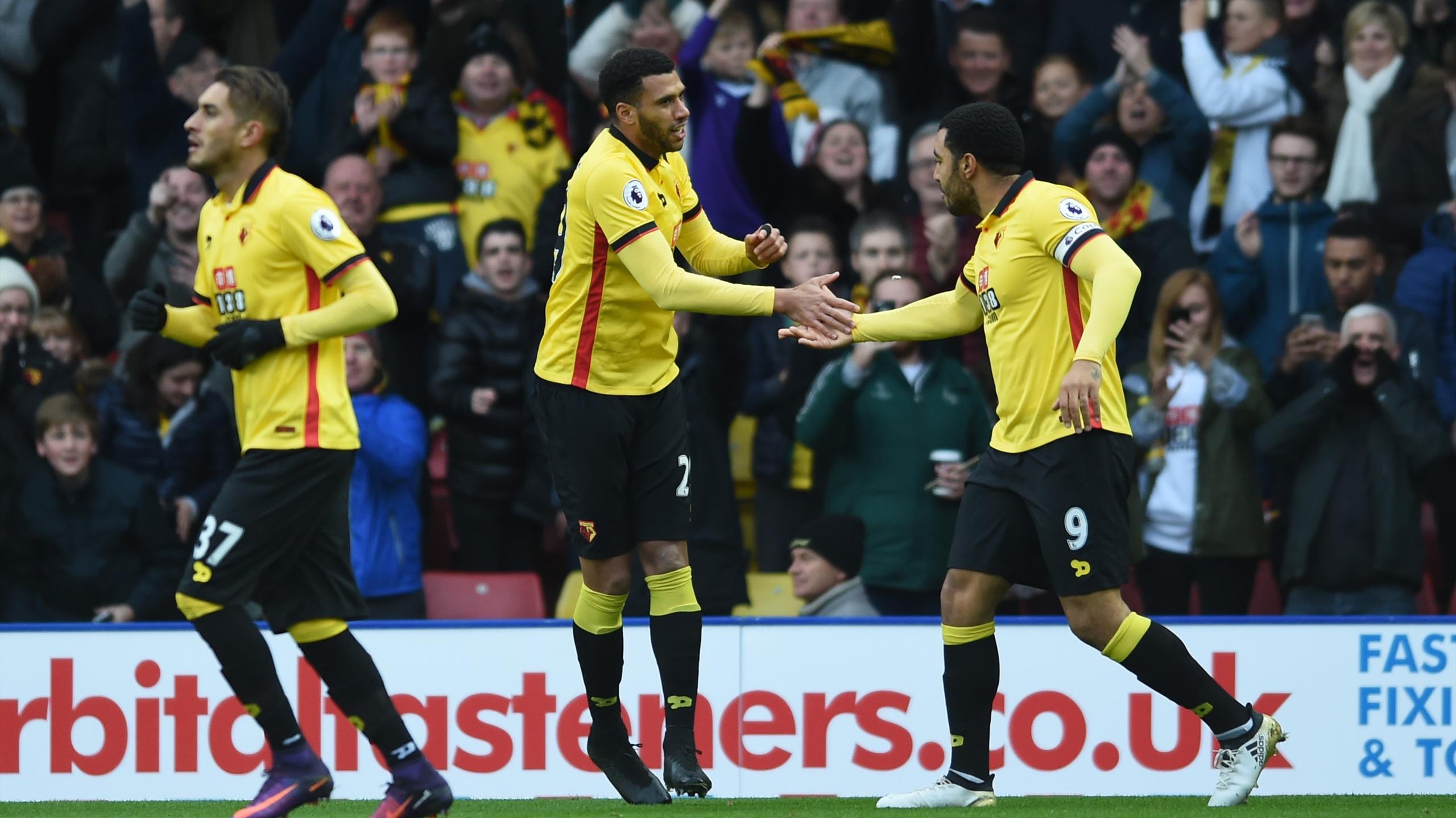 Etienne Capoue celebrates scoring their first goal