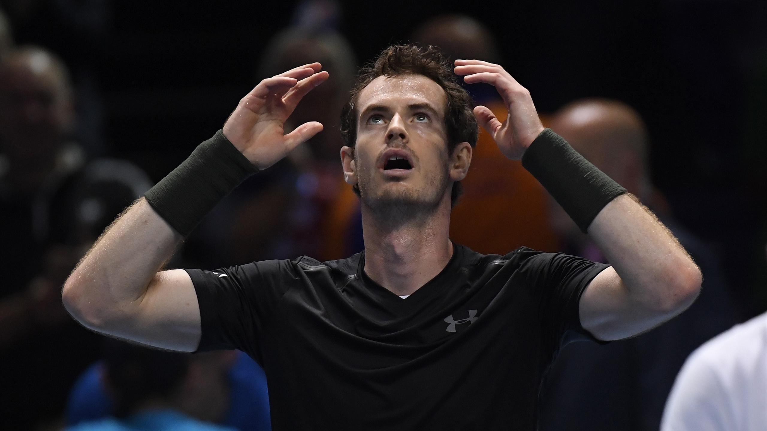 Great Britain's Andy Murray celebrates winning the final against Serbia's Novak Djokovic