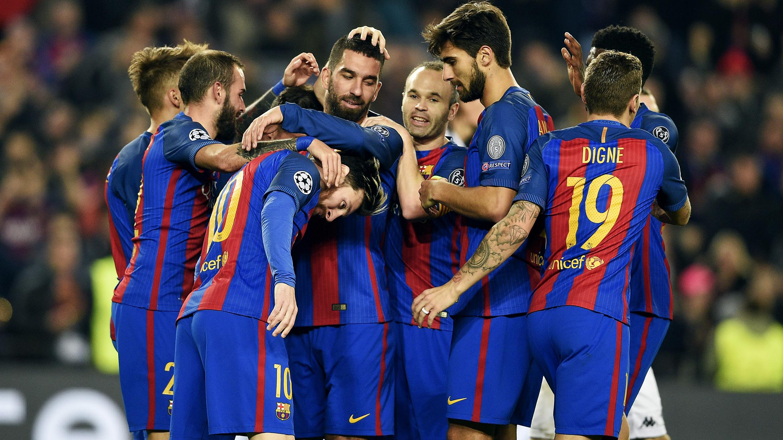 Barcelona's Turkish forward Arda Turan (C) celebrates with teammates