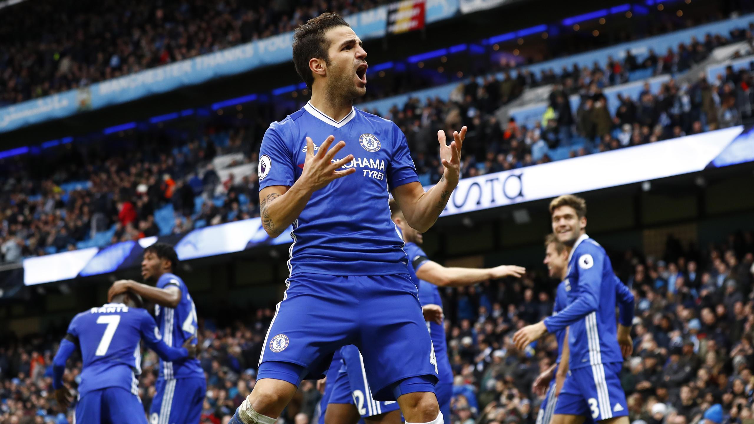 Cesc Fabregas celebrates their third goal scored by Eden Hazard
