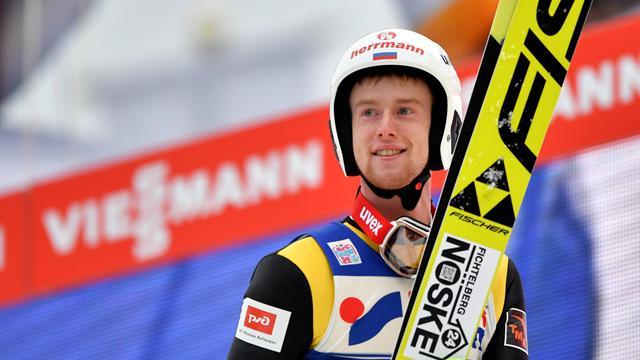 Климов занял третье место на этапе Турне четырех трамплинов