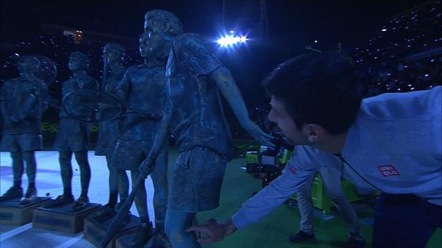 Djokovic tries to distract human statue in Doha