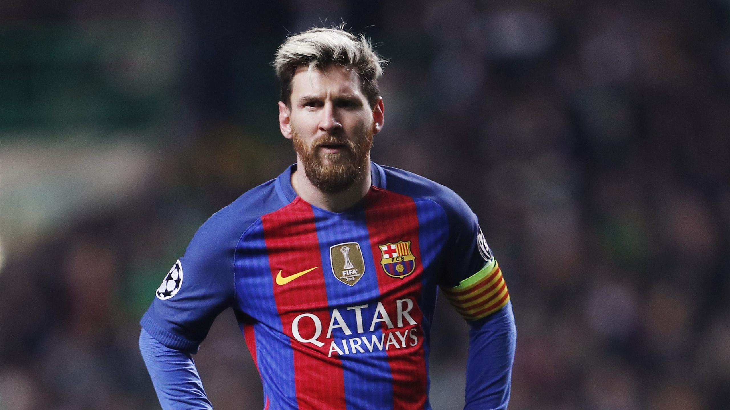 Barcelona's Lionel Messi stands with his hands on his hips