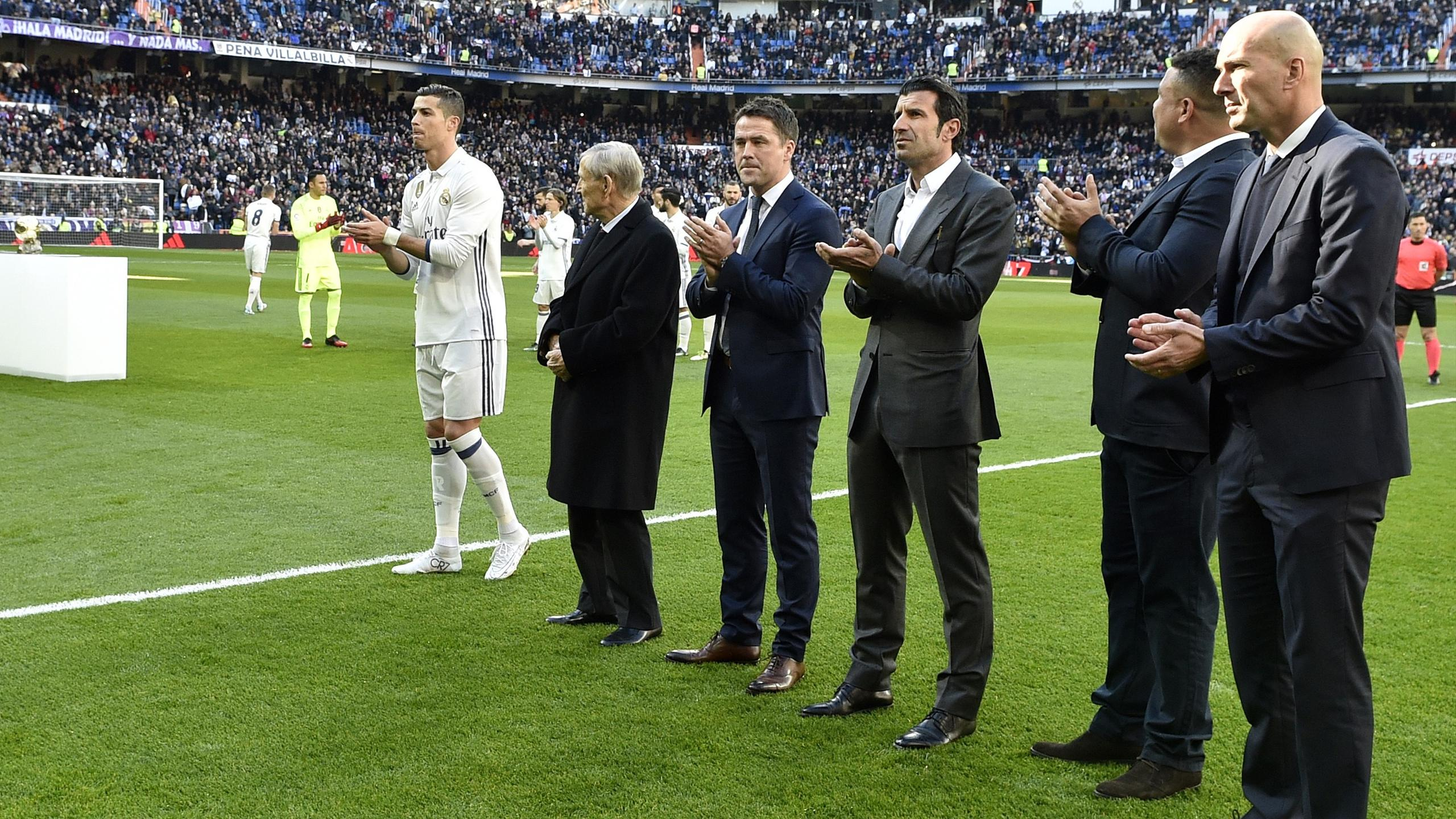 Real Madrid's Portuguese forward Cristiano Ronaldo, former football players French Raymond Kopa, British Michael Owen, Portuguese Luis Figo, Brazilianb Ronaldo Nazario and Real Madrid's French coach Zinedine Zidane