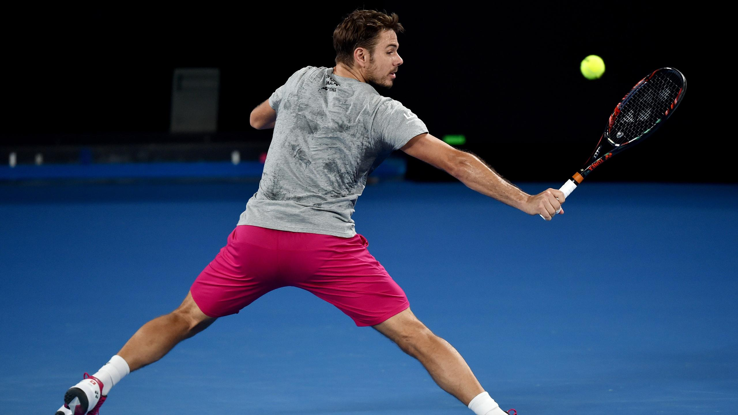Stan Wawrinka of Switzerland hits a return during a practice session