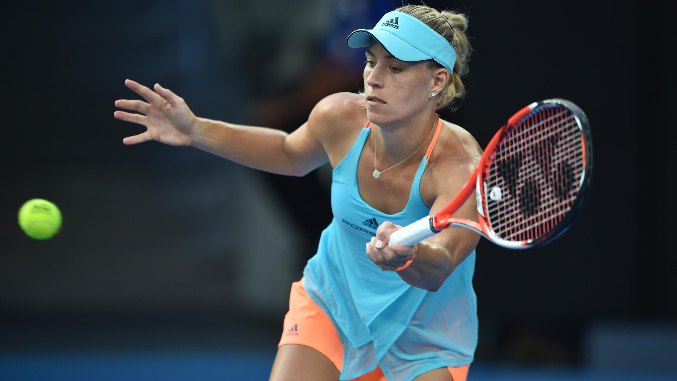 Germany's Angelique Kerber hits a return against Ukraine's Lesia Tsurenko
