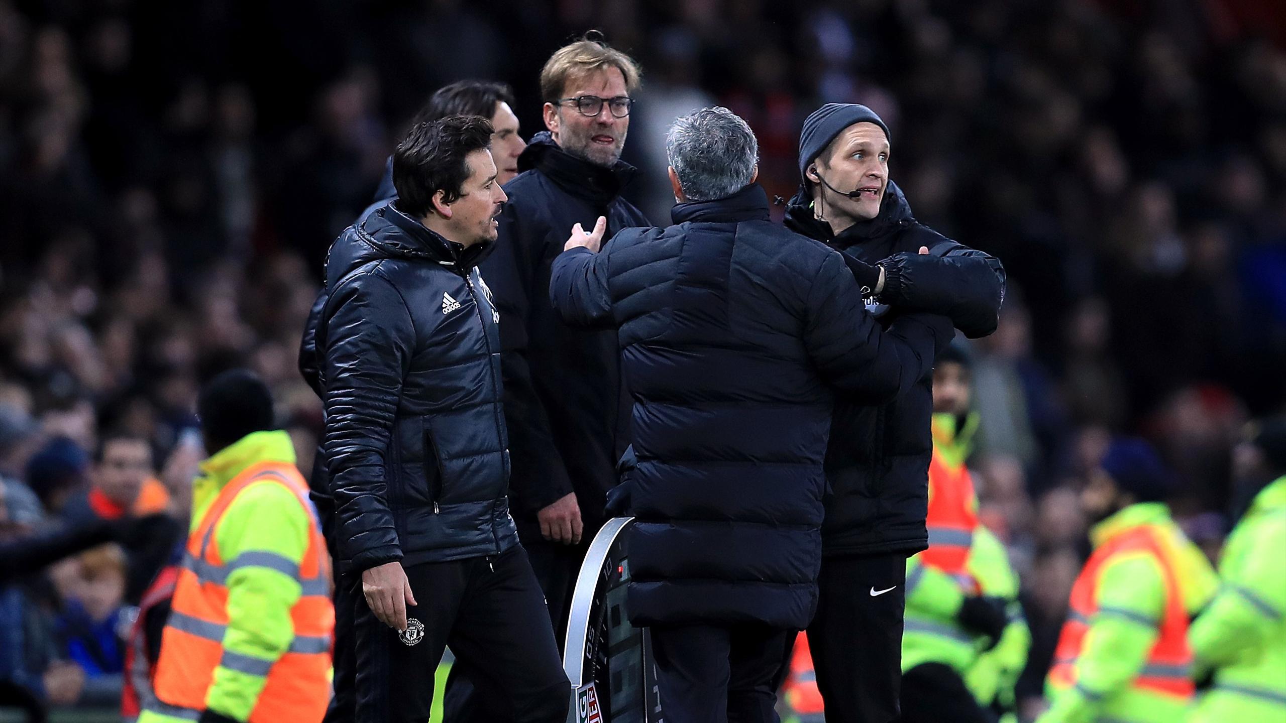 Manchester United manager Jose Mourinho (front) and Liverpool manager Jurgen Klopp (back) exchange words